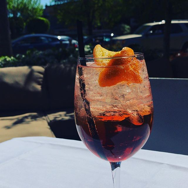 What better way to enjoy the sun than by drinking an Aperol Spritz on our beautiful patio? They're also currently on special for our Happy Hour (bar and couches only)           #seattlehappyhour #happyhour #seattlerestaurants #authenticitalian #drinks #seattlesun