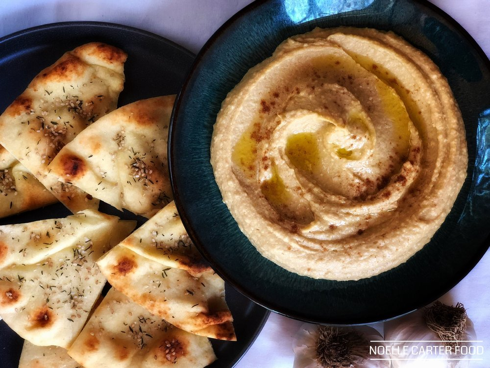 ROASTED GARLIC HUMMUS WITH BAKED FLATBREAD CHIPS.