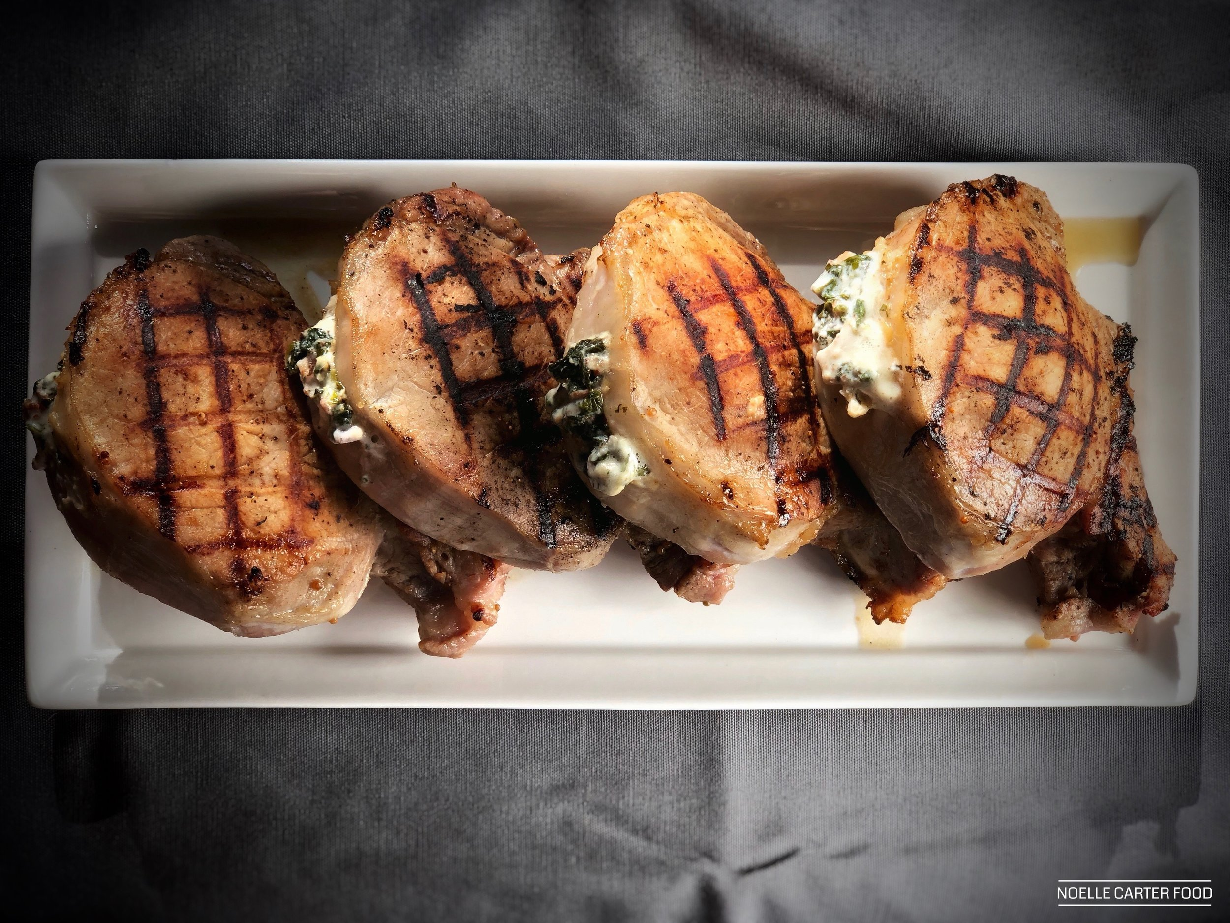 Grilled stuffed pork chops. (Noelle Carter