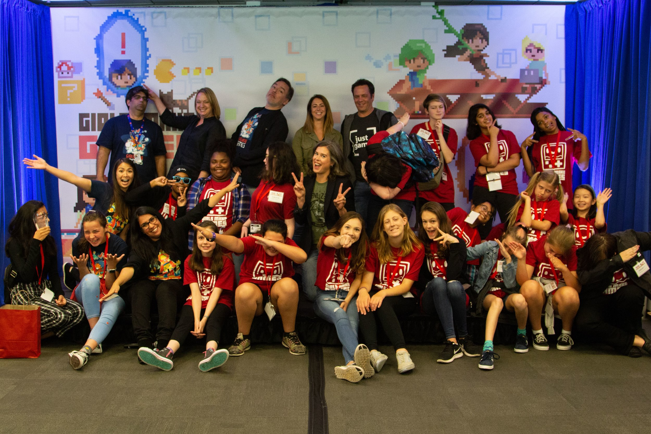 Judges Connie Booth, Phil Spencer, Shawn Layden, Anna Sweet and Devon Pritchard with the 5 finalist teams, GMG ambassadors and staff celebrating the end of 2018 Demo Day!