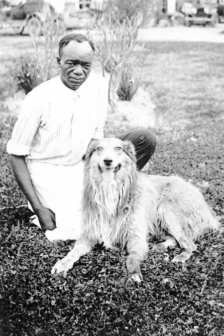 blackman_wearingapron_dog_c1915_1920_14379690607_o.jpg