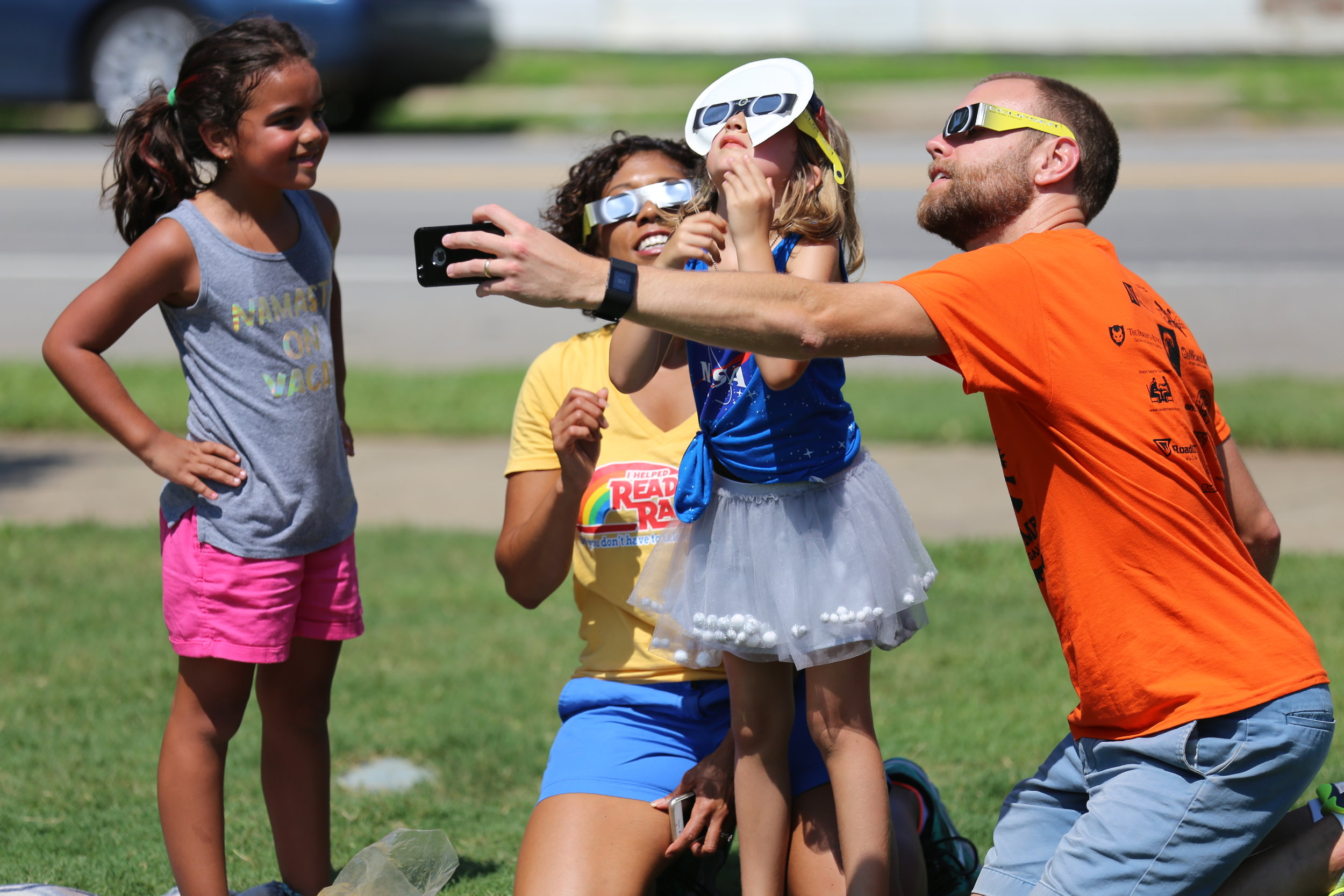 solar eclipse family at Town Square.JPG