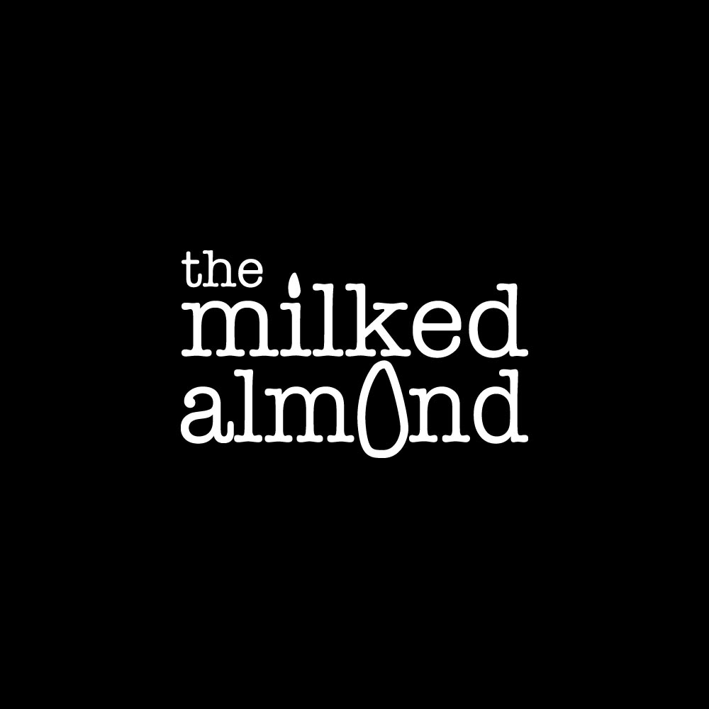 TheMilkedAlmondLogo_WHITEon Black SQuare.jpg