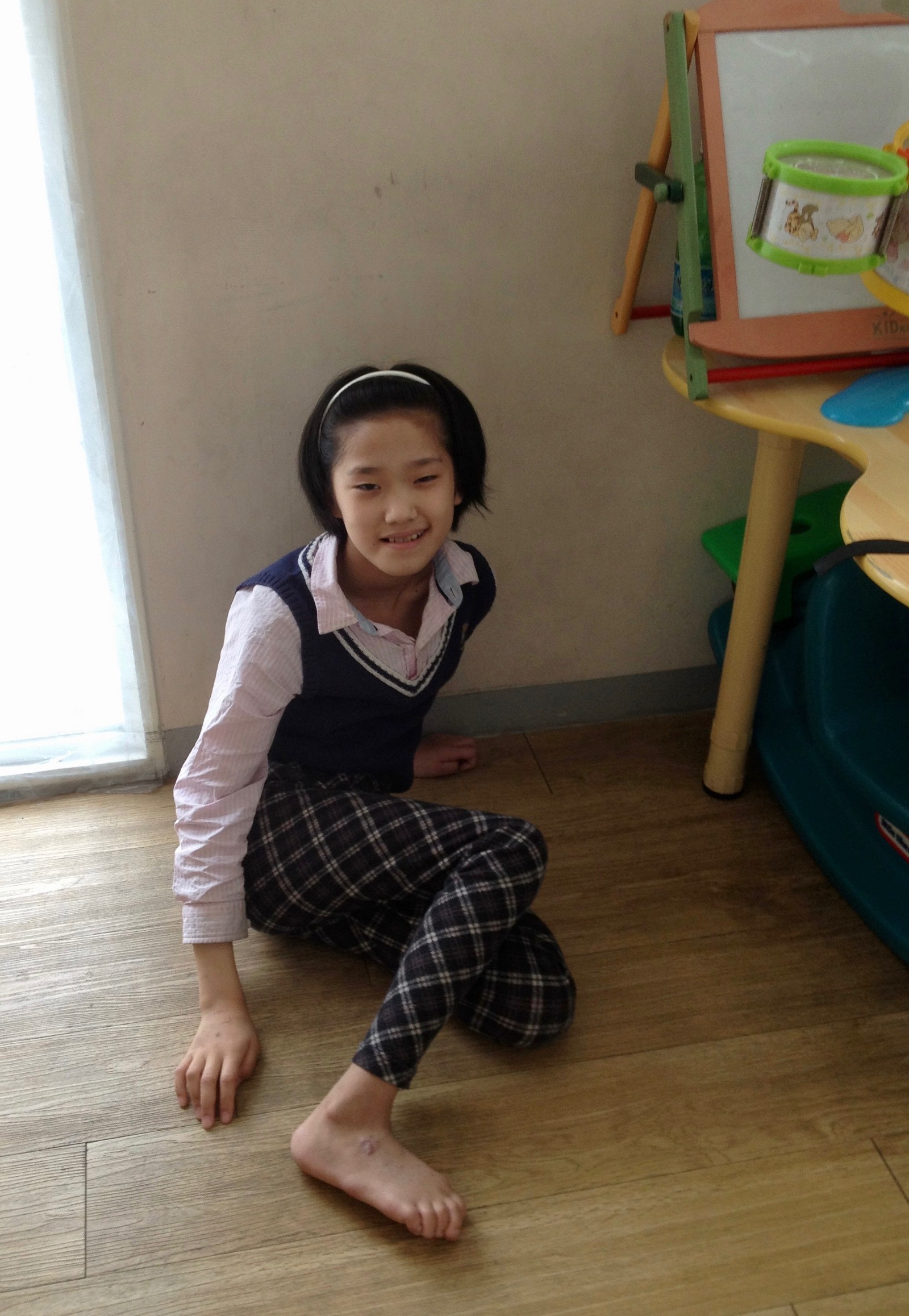 Ten year-old girl treated for cerebral palsy in the Pyongyang Medical School Hospital