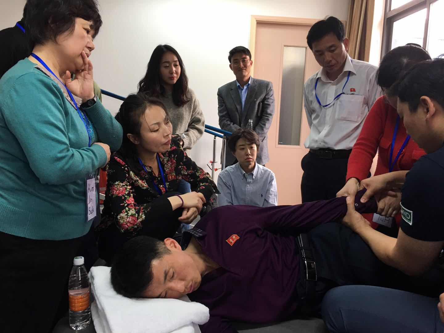 North Korean doctors practicing Bobath Therapy Techniques in Shanghai, China