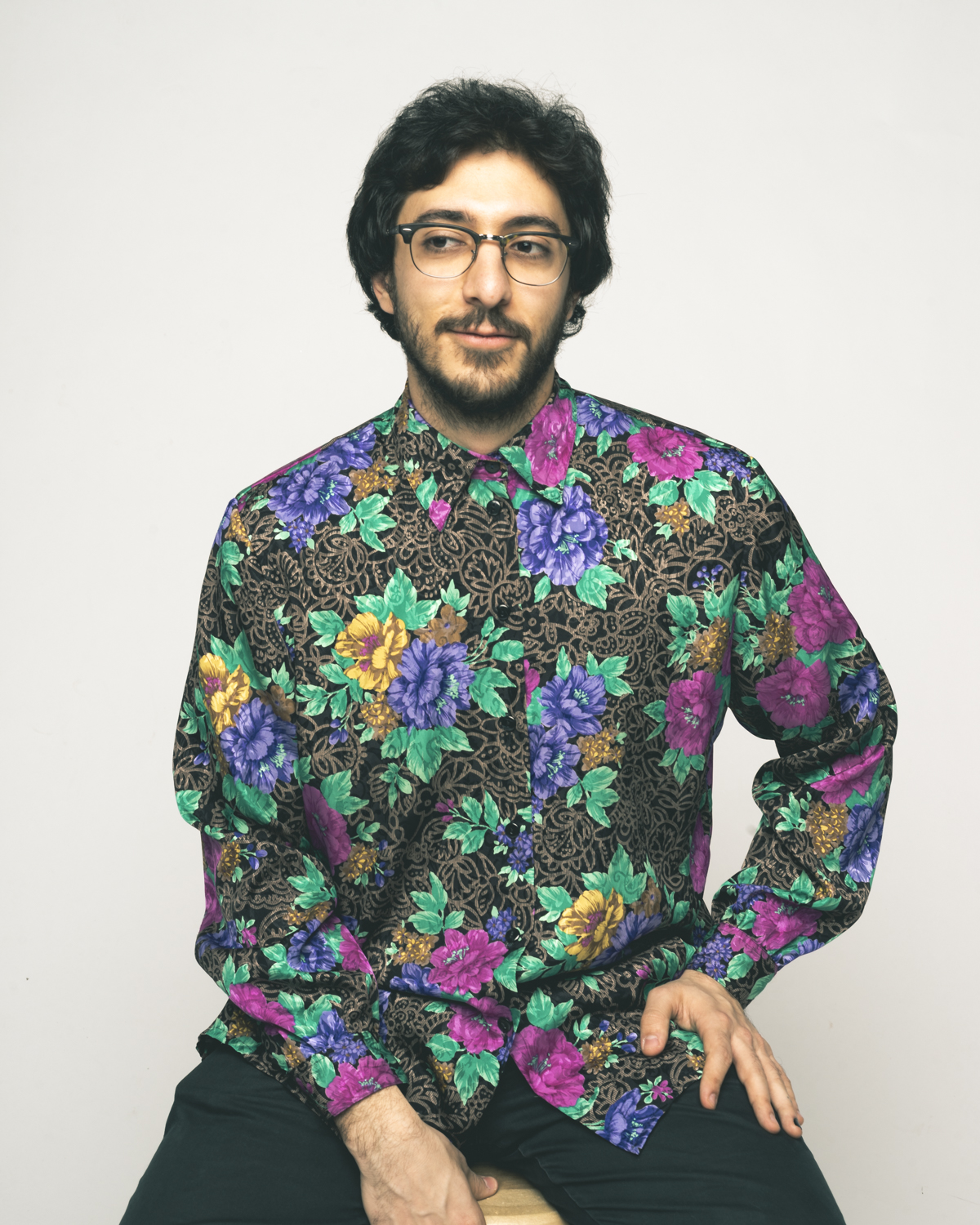 Behrooz Mihankhah - E.Piano/keys - He commands a rich taste in music which is only matched by the taste in his shirts. He was one of the very first members to join Superfluid and play through it's many forms in the first couple of years. A jazz aficionado, Behrooz can be found in the classrooms and libraries of St FX University trying to grasp a deeper understanding of the musical cosmos when he is not slaying a Superfluid set at a festival, theatre, hall or pub near you. He is also the composer/bandleader/e.piano player for his jazz/fusion project Lazeez.