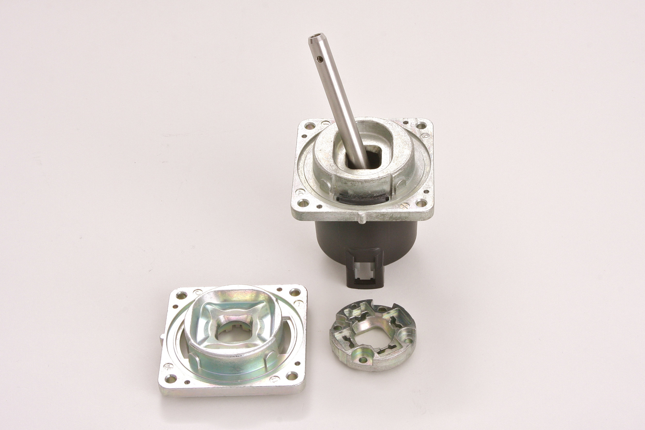 Zinc Castings vs screw machine products - Zinc die casting produces features that are difficult or impossible from bar or tubular stock, while maintaining tolerances without tooling adjustments, with fewer operations, and less scrap.