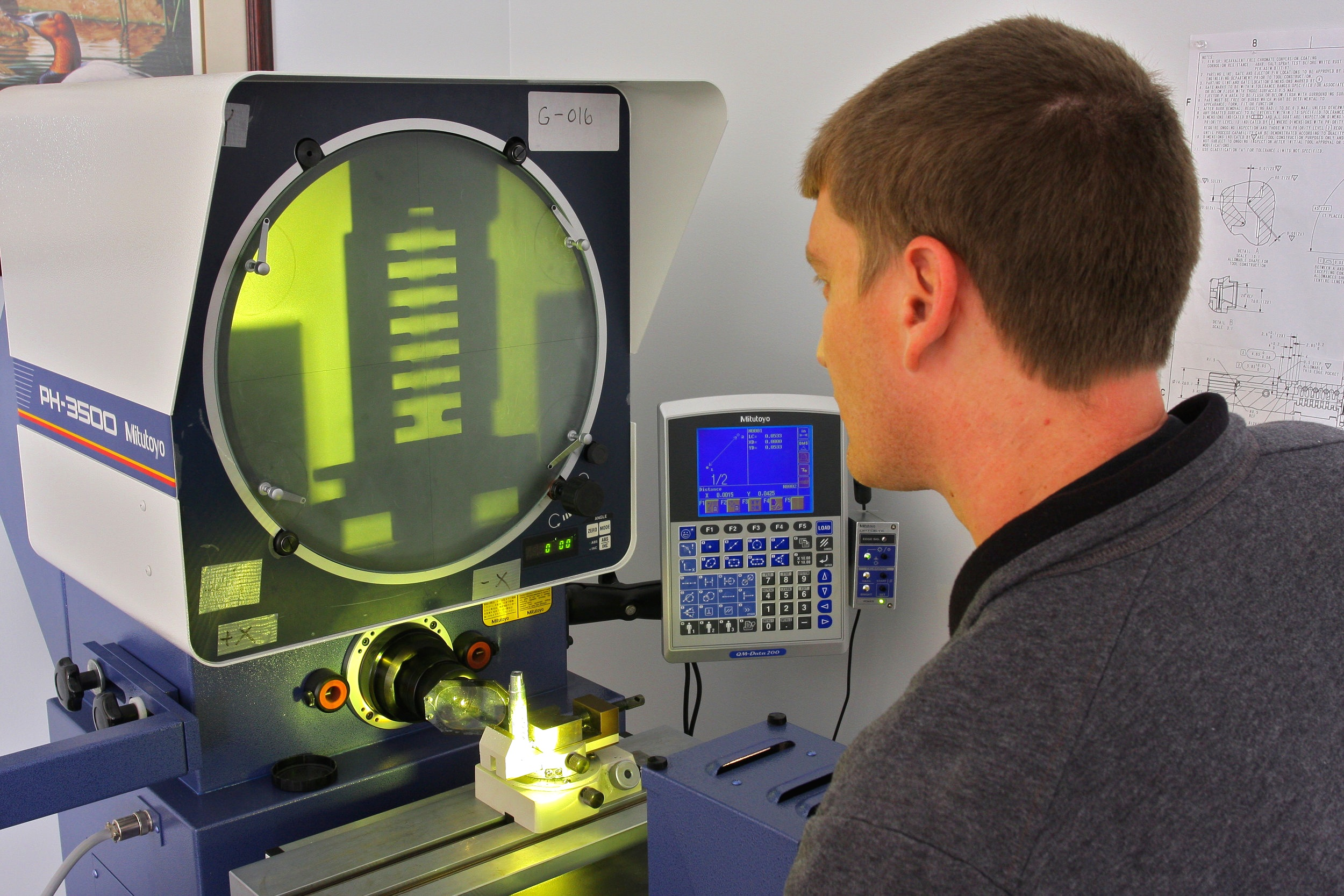 Our Mitutoyo PH-3500 Optical Comparator with attached 2D Data processor allows us to perform quick and accurate optical checks for features such as thread pitch.