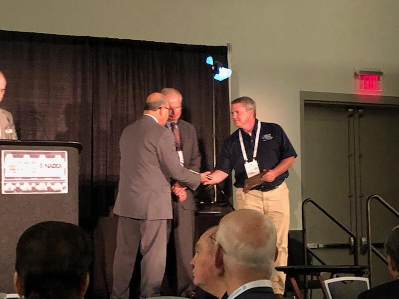 Lakeside COO Tony Miller accepts the NADCA design award for a zinc die casting under 6 oz