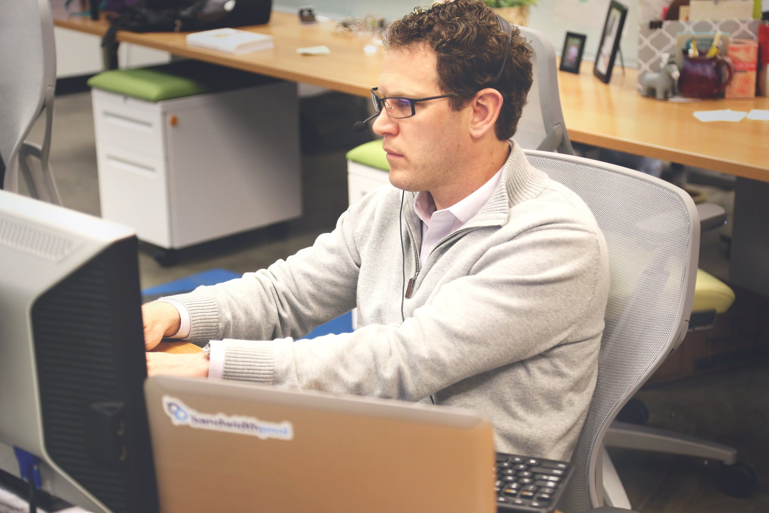 Man in office at computer working