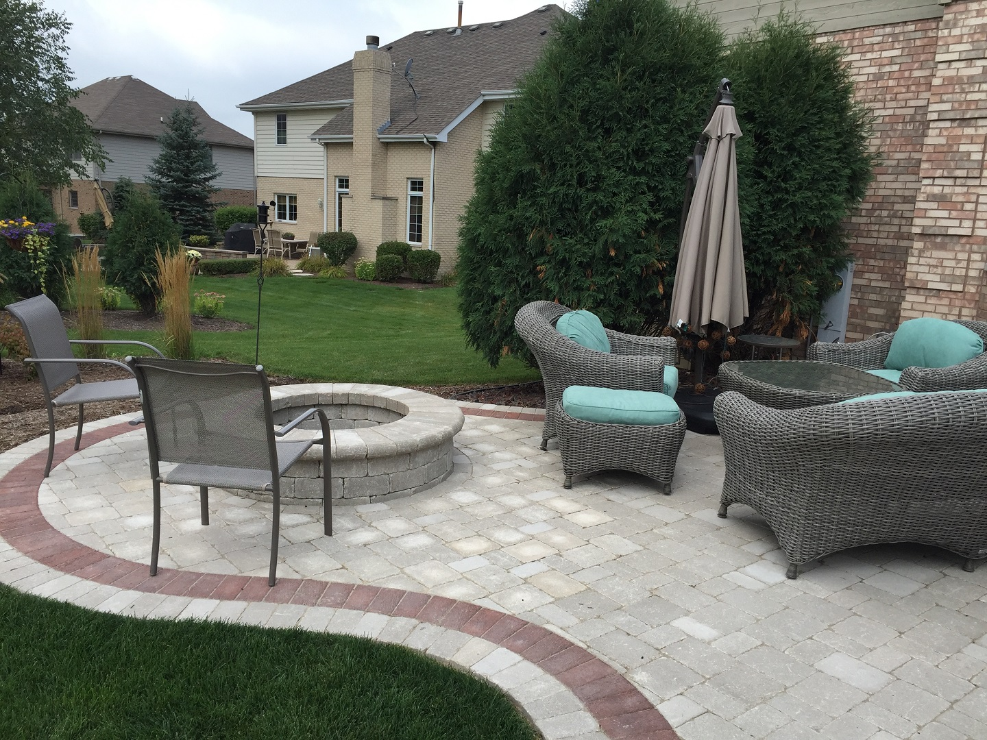 Brick patio with fire pit in Peotone, IL