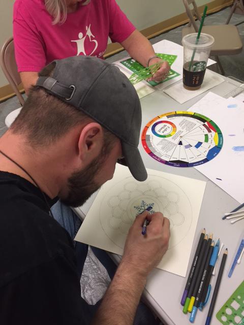 stephen starting color his mandala.jpg