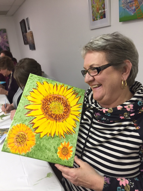 lizs mom smiling with finished painting.jpg
