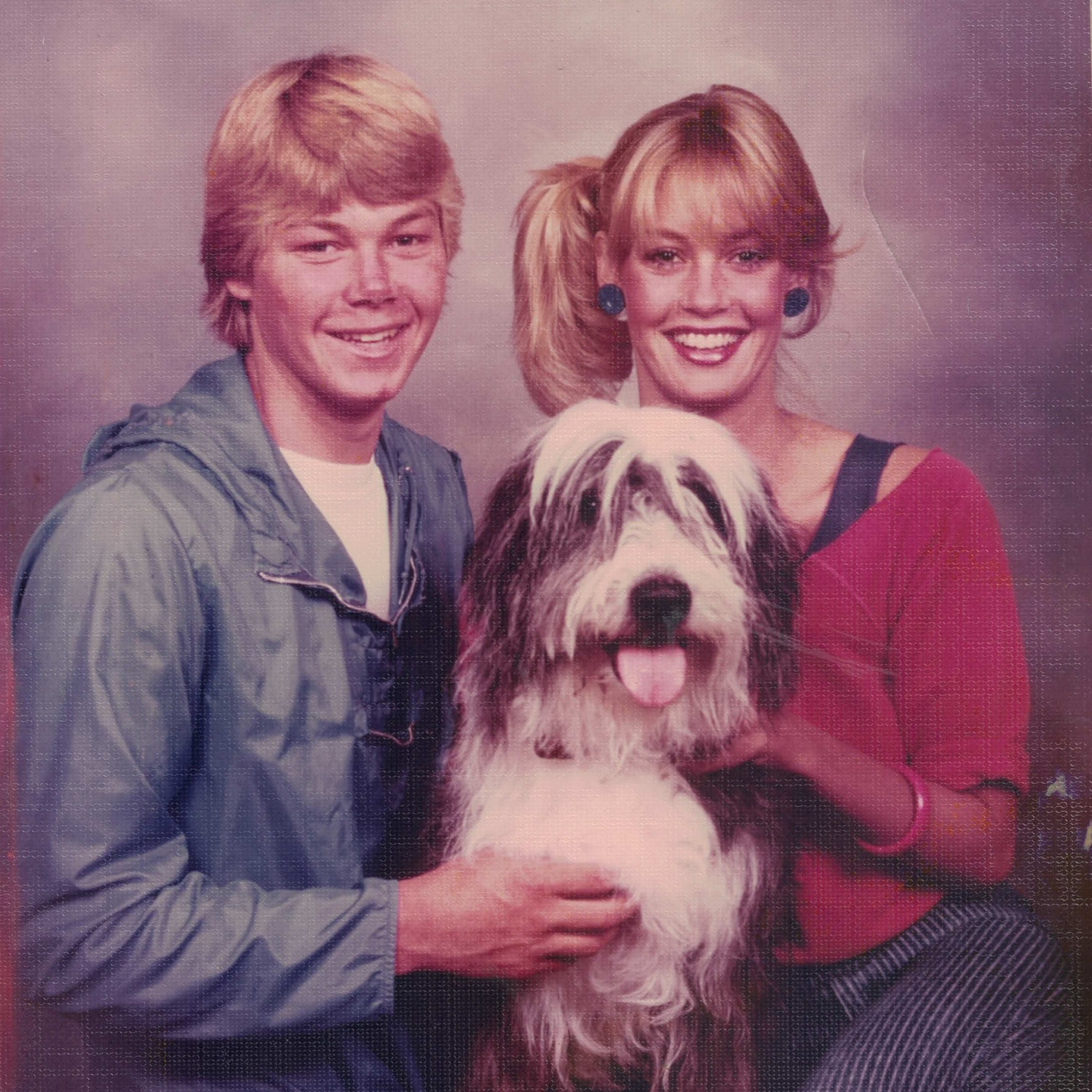 With her brother Rob and family dog Bumper