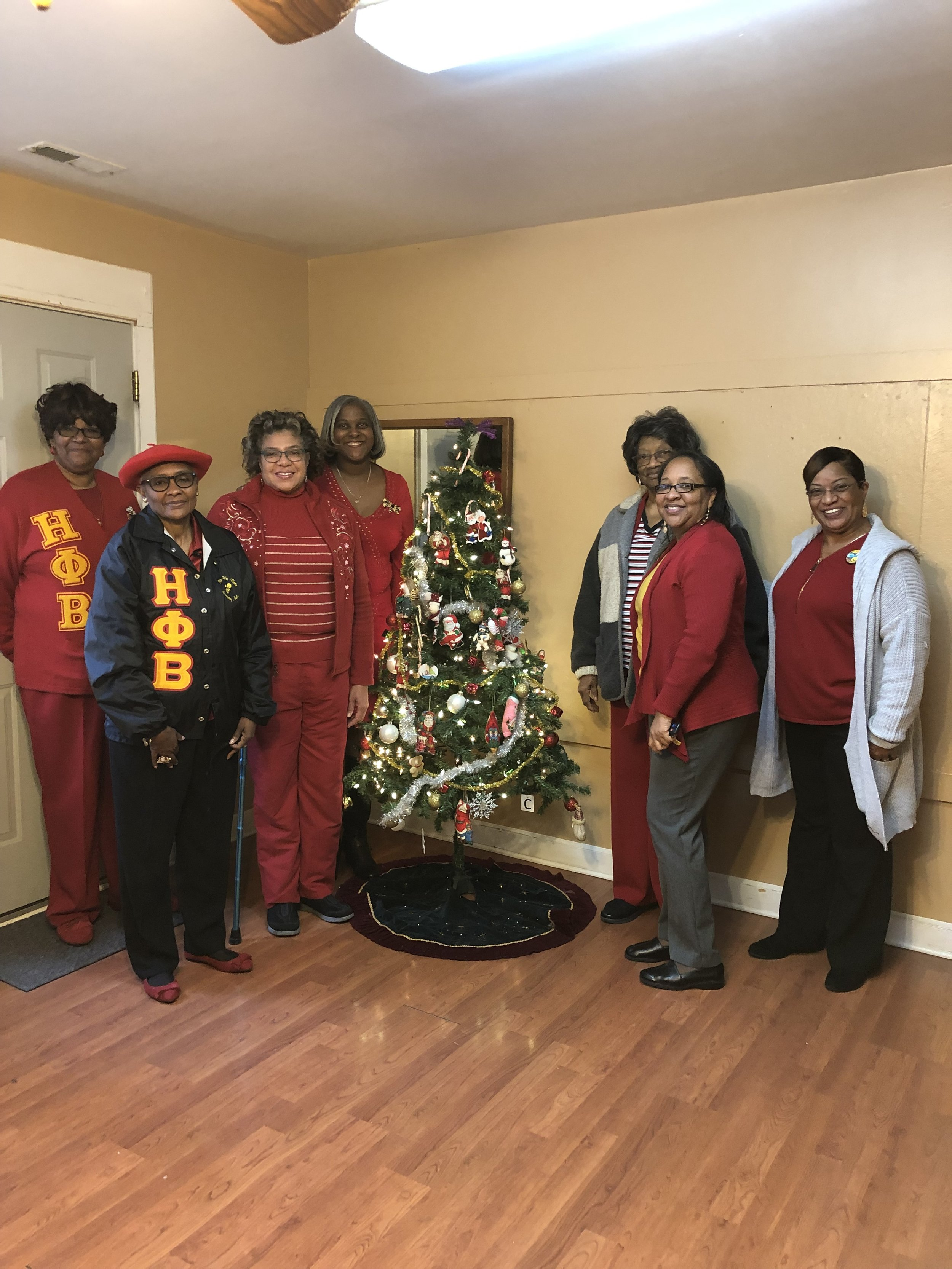 Alpha Theta visits the Domestic Violence Center of Durham, N C in December 2018.  They presented sweaters for the female residents.