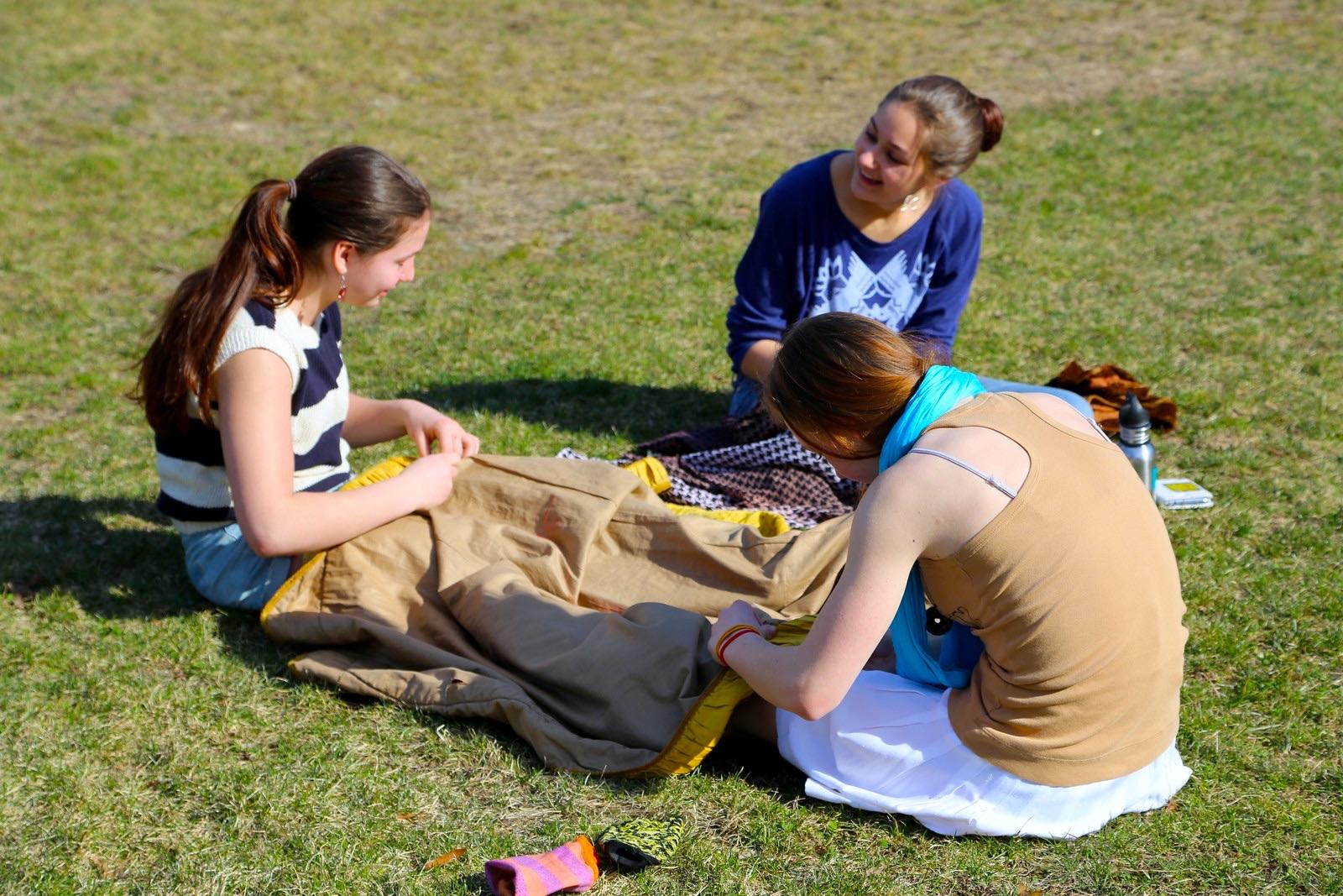 trio sew on grass.jpg