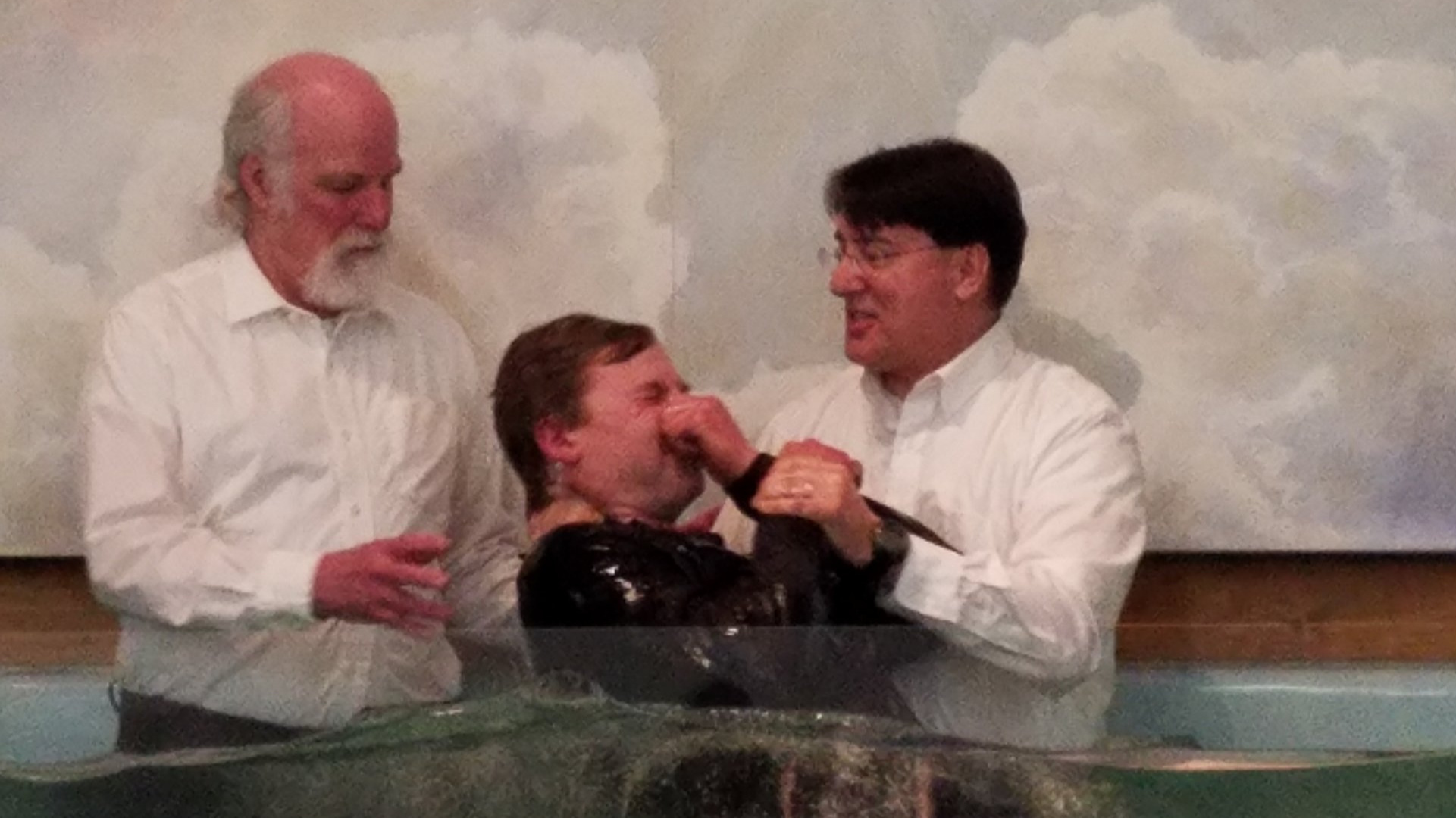 Water baptism during a Sunday service at West Rockport Baptist Church