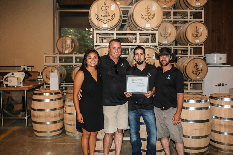 Distiller's Hand Elizabeth Carbajal, Owner Jody Garrett, Head Distiller Bill Garrett, and Distiller's Hand Ben Vantassel.