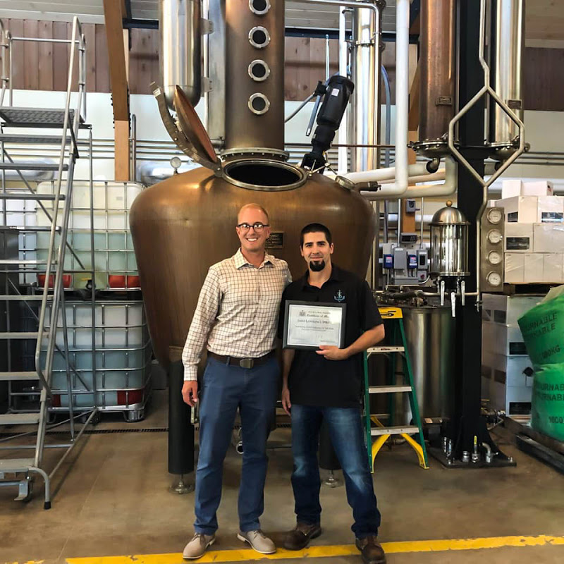 NYS Assemblyman Mark Walczyk and Head Distiller Bill Garrett with the Certificate of Merit.