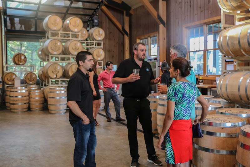 Bill and Saint Lawrence Spirits NNY Sales Representative, Andy Beimford, discussing the distilling process with guests.