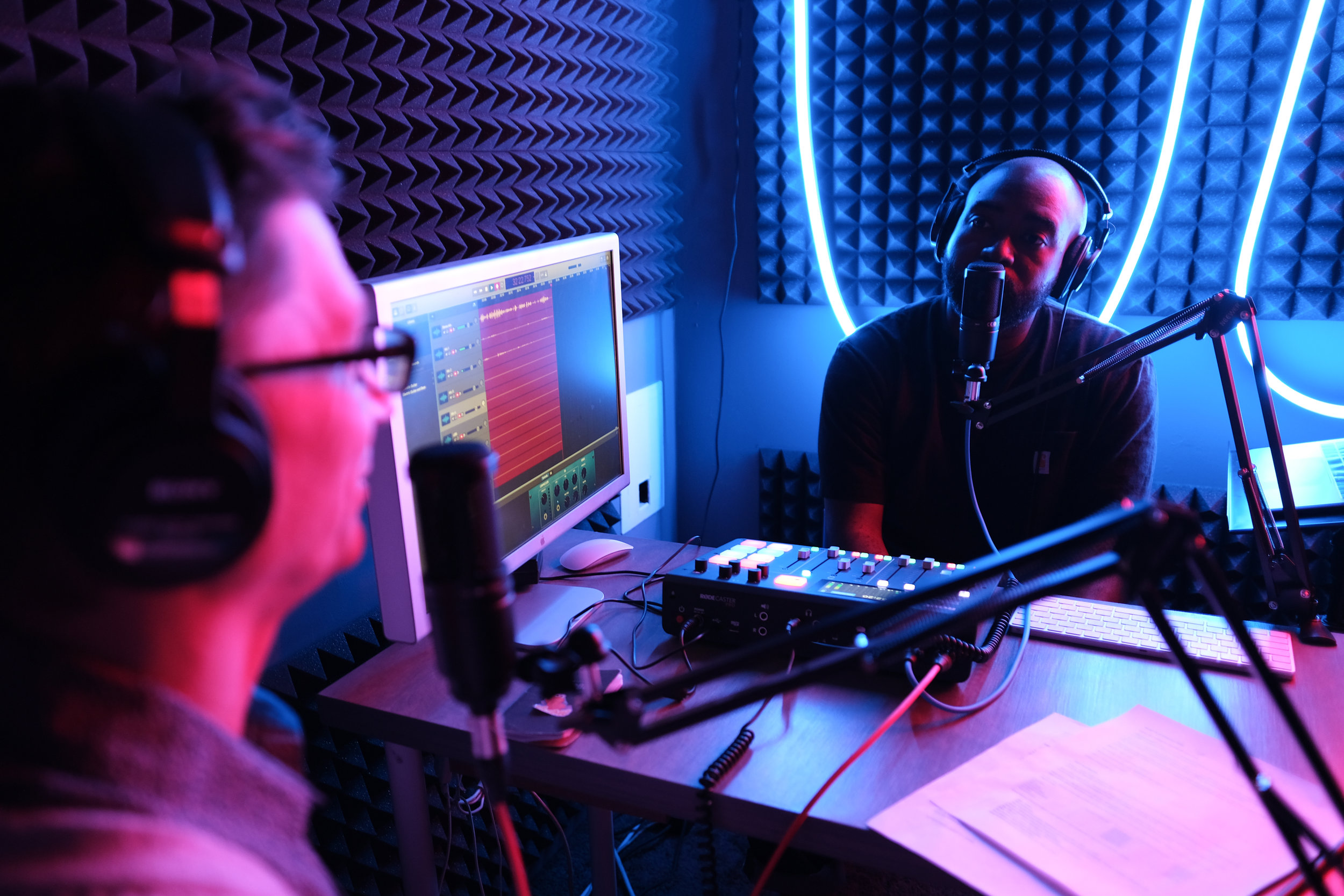 Alex and Ernest recording an episode of Office Hours in Studio A.