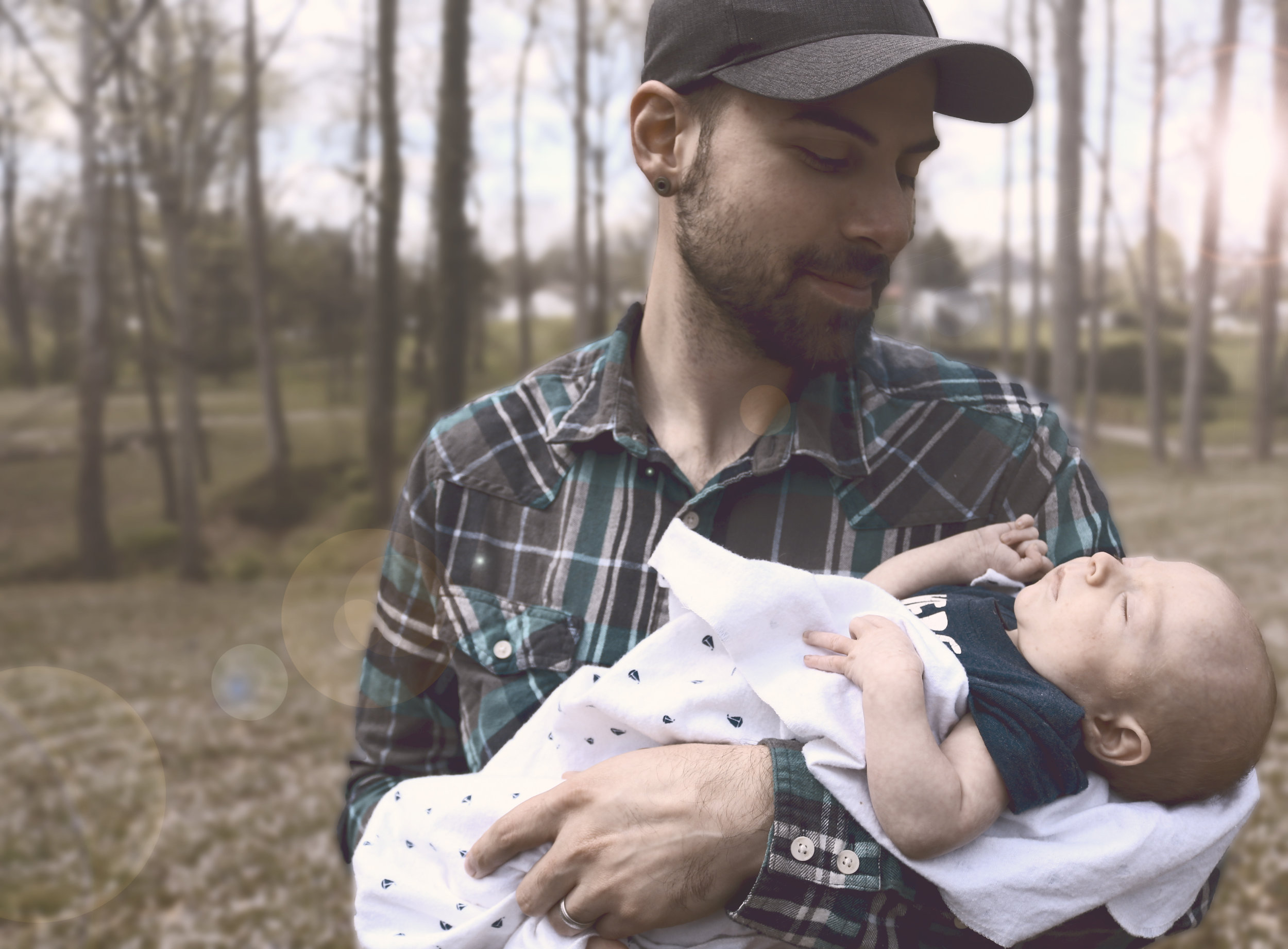 Canva - Man Holding Baby during Daytime.jpg
