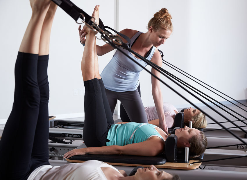 Reformer Pilates - Create more body awareness, improve strength, flexibility, and mobility while reducing stress on muscles and joints using the reformer. We offer private and semi-private reformer sessions as well as daytime and evening classes.