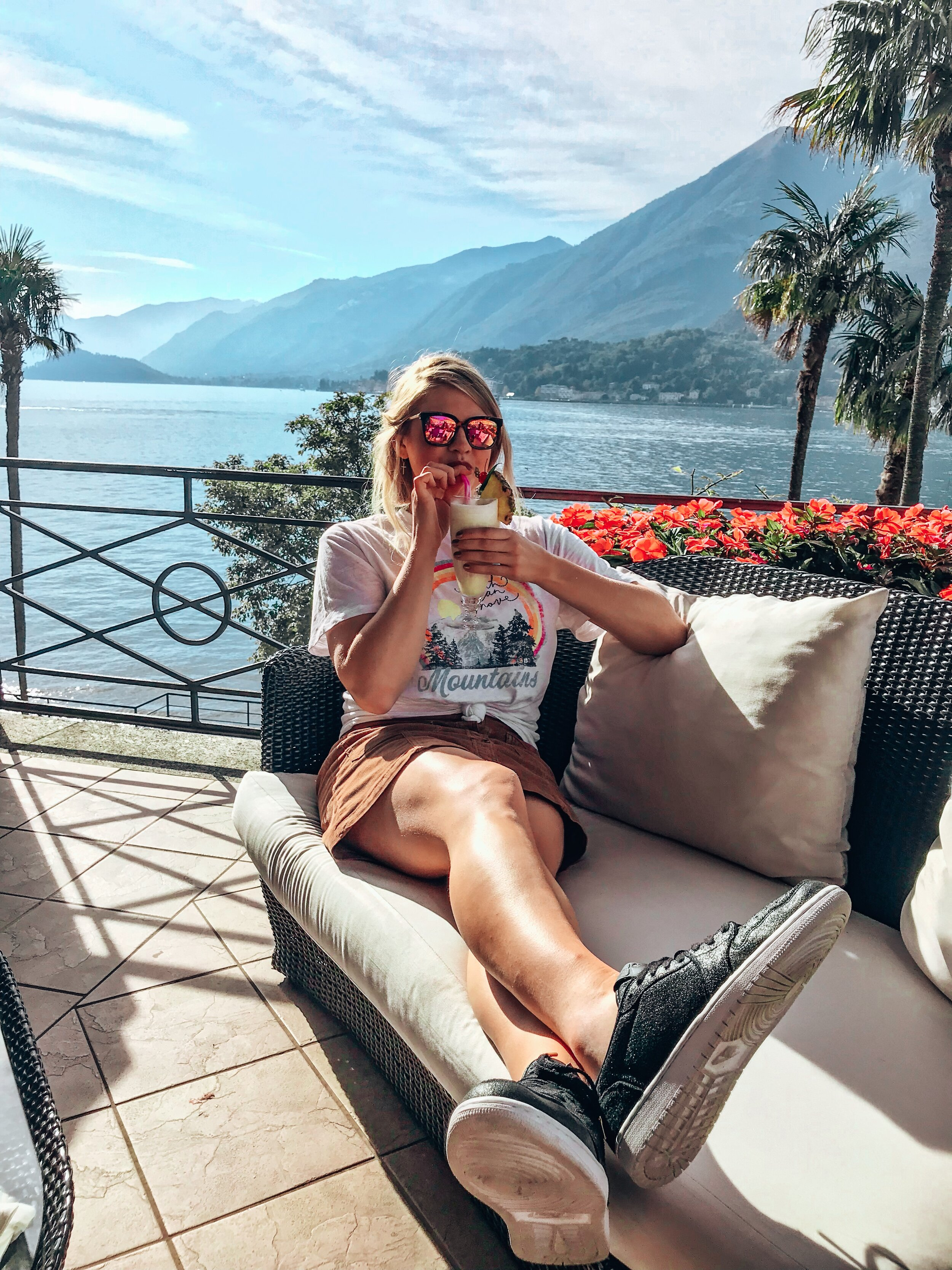 Enjoy the Views at Grand Hotel Villa Serbelloni - The views won't be the only thing you'll want to enjoy while at the Grand Hotel Villa Serbelloni…grab a cocktail with your bestie and relax some at Travel & Leisure's Number One Hotel in Italy 2019. Pictured: the best and most expensive piña colada I've ever had!