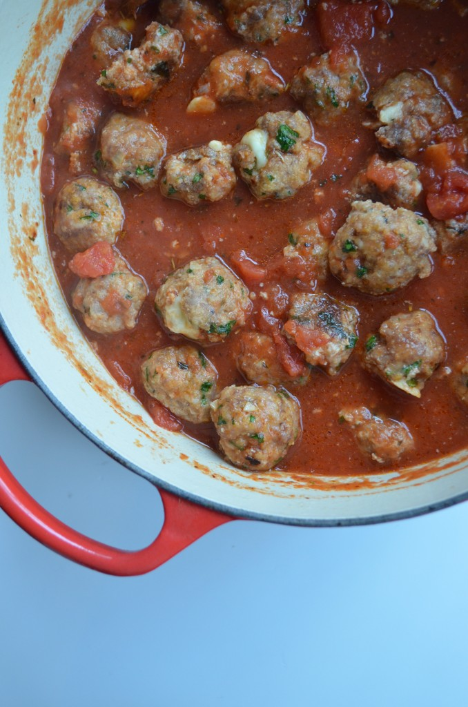 Spicy Smoked Mozzarella Stuffed Meatballs with Tomato Sauce From Scratch with Maria Provenzano Click for recipe!