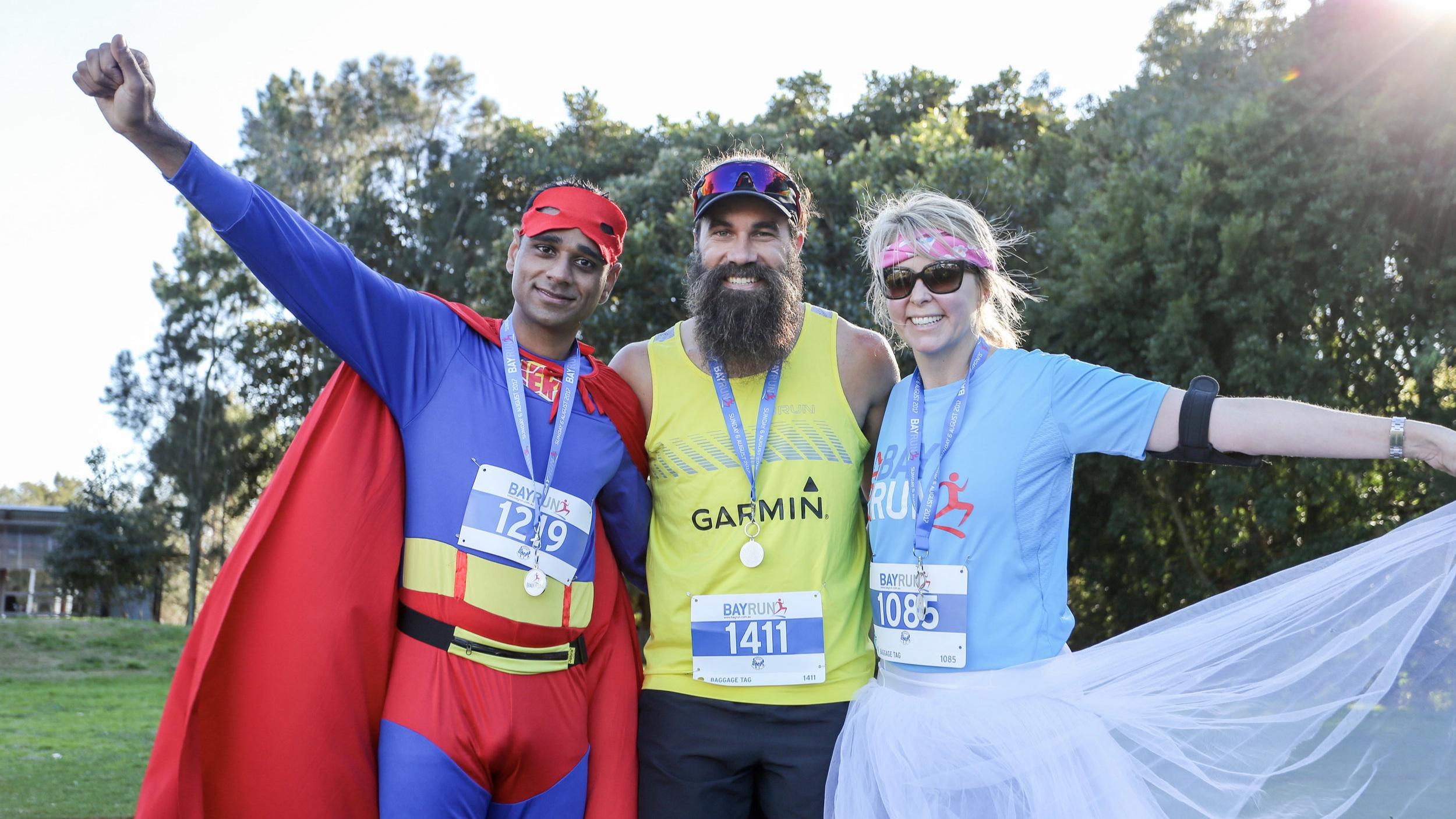 Best Costume Winners BayRun 2017 with the GARMIN Running MAN. Photo courtesy Rhys Logan