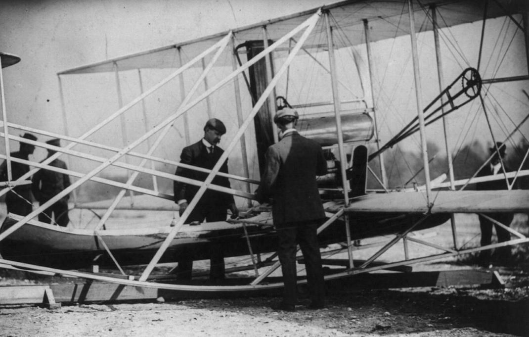 Wilbur examines before flight.jpg