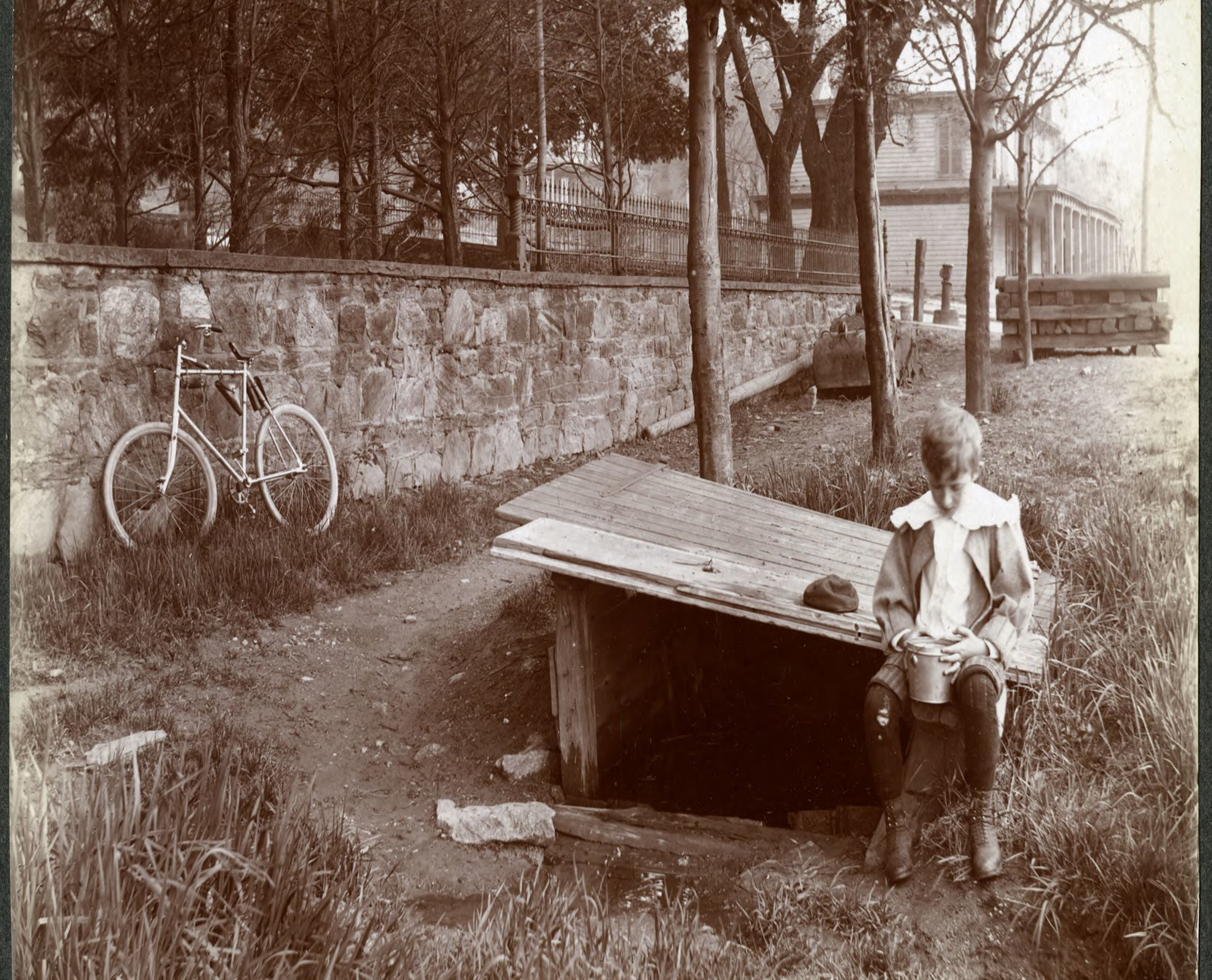 Unidentified boy at a well on the Hudson River shore at W. 158th Street, New York City, May 13, 1898..jpg