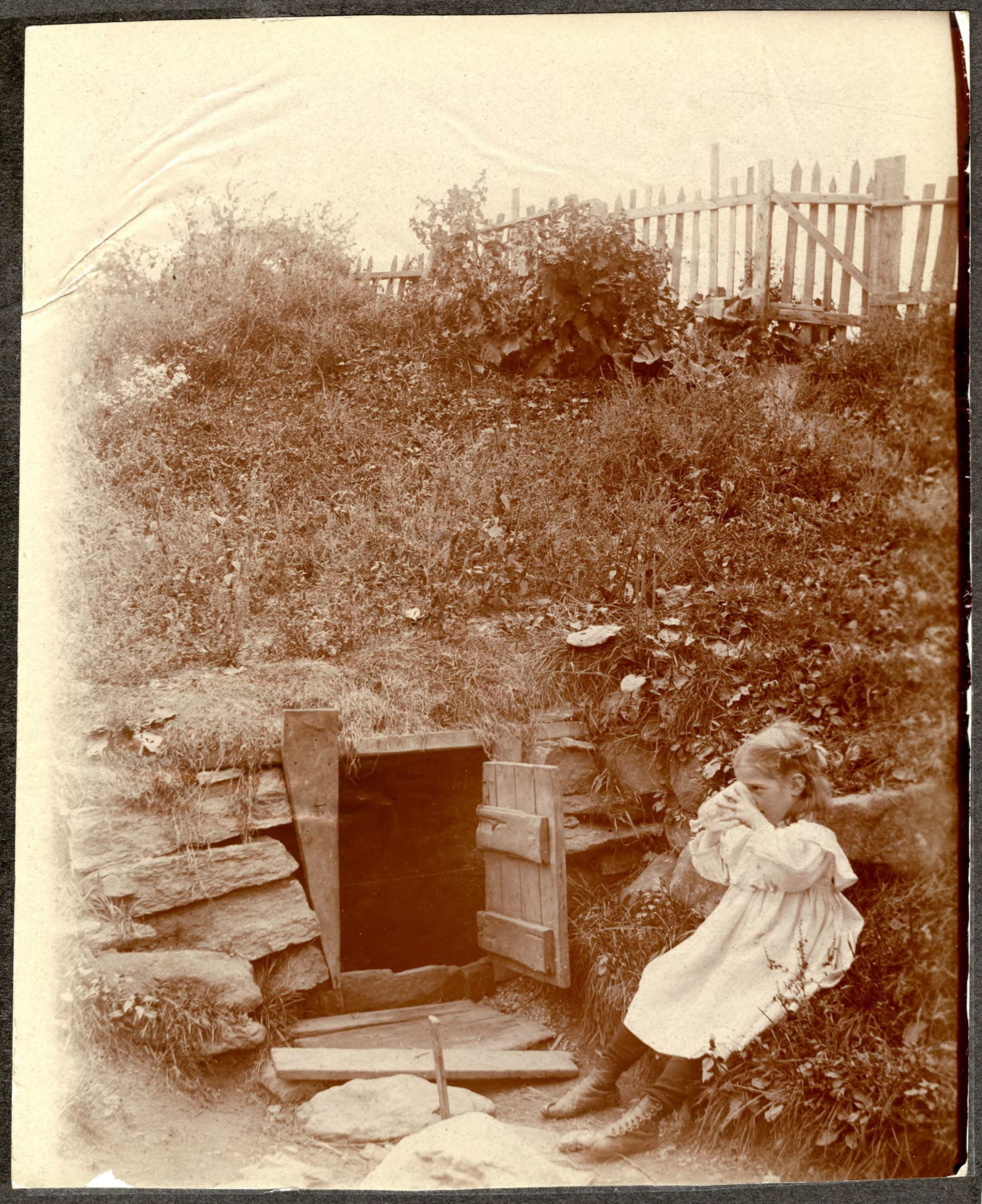 Unidentified girl drinking from a spring on the east side of Broadway between W. 184th and W. 185th Street, New York City, September 19, 1897..jpg