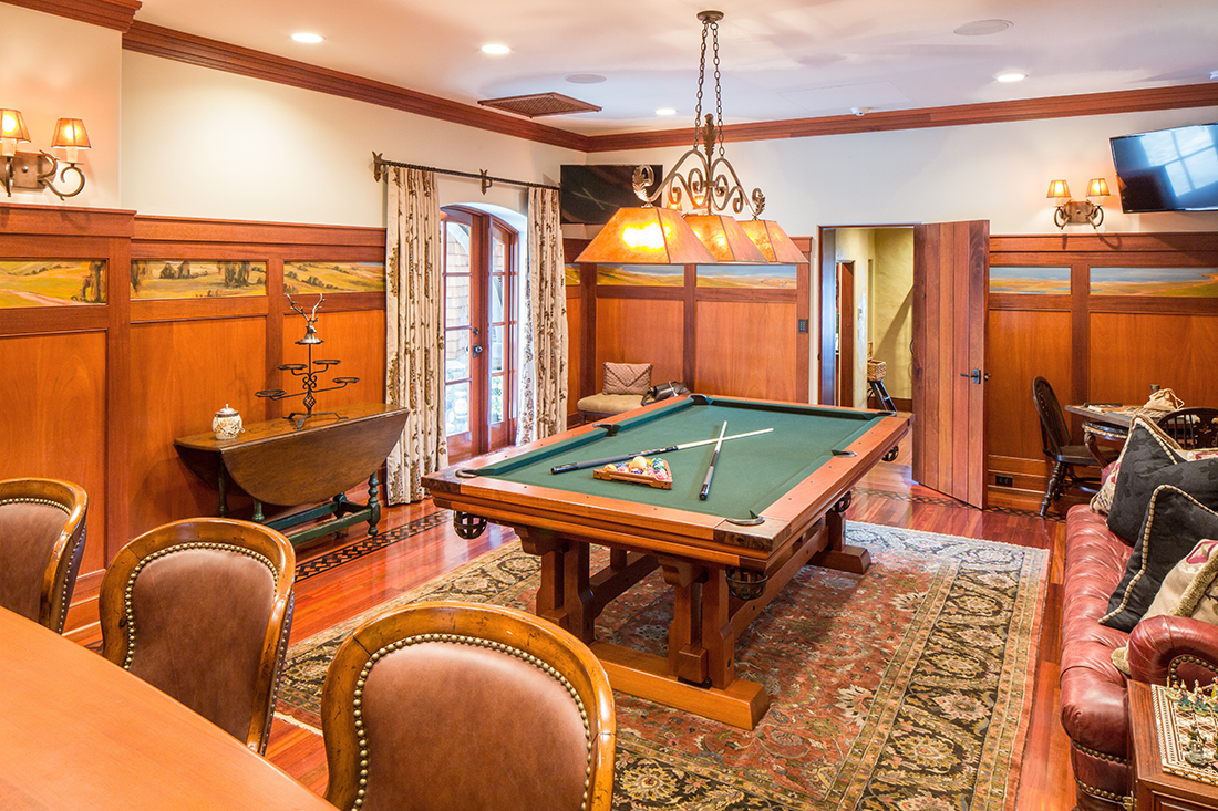 "Two 50"" LED TV's with independent control enhance the Billiards and Bar Room. More impressive are the hand-painted panels that imagine the home's surrounding terrain 200 years ago."