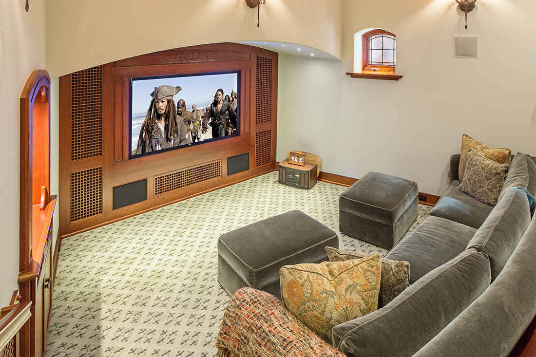 "This intimate dedicated theater features a 70"" Plasma TV, and 7.1 Surround from Arcam and Triad."