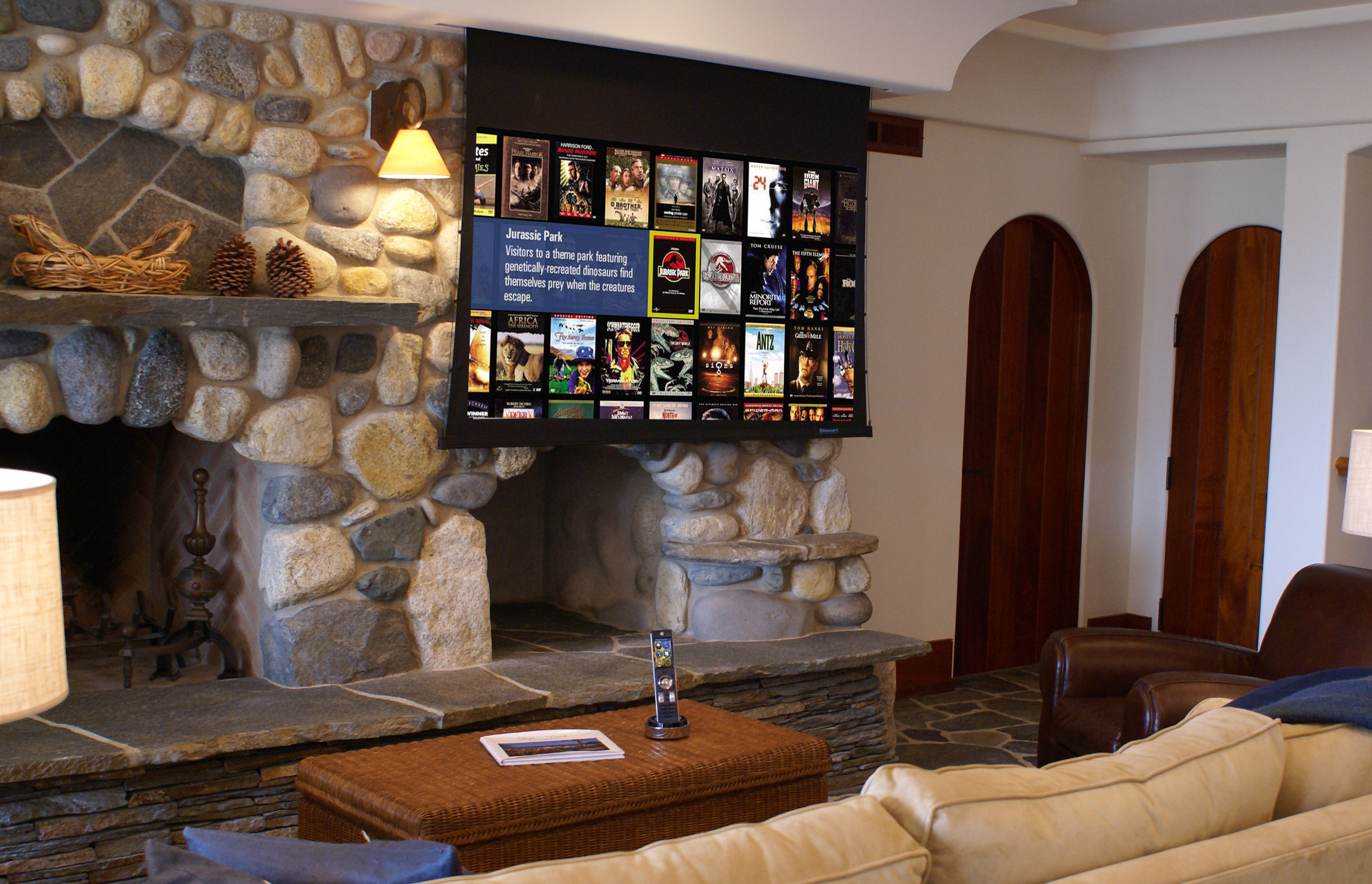 One of two media rooms on property, this motorized Stewart screen system disappears when not in use.
