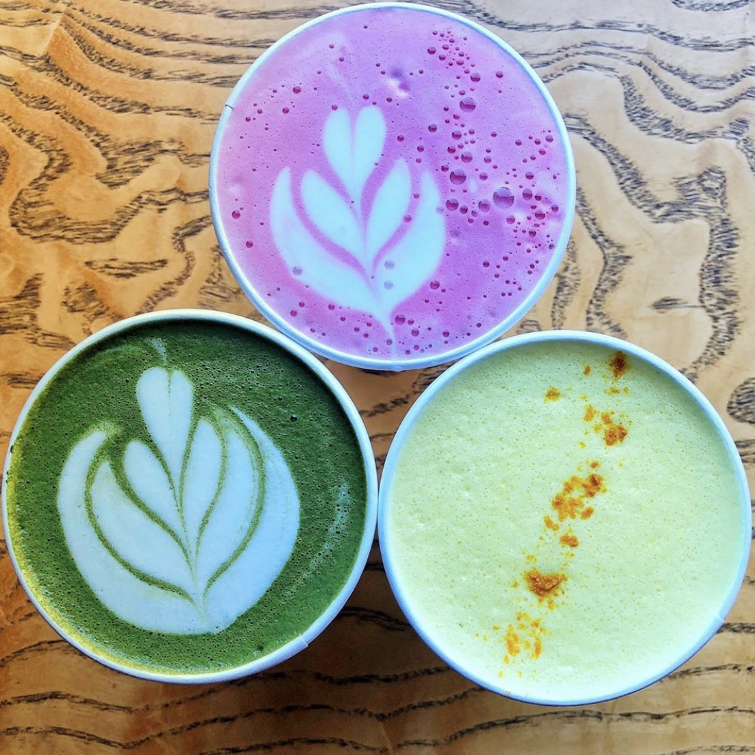 A colorful variety of wellness lattes made with High Lawn Farm milk by Holli Badger at Fuel Bistro, in Great Barrington MA