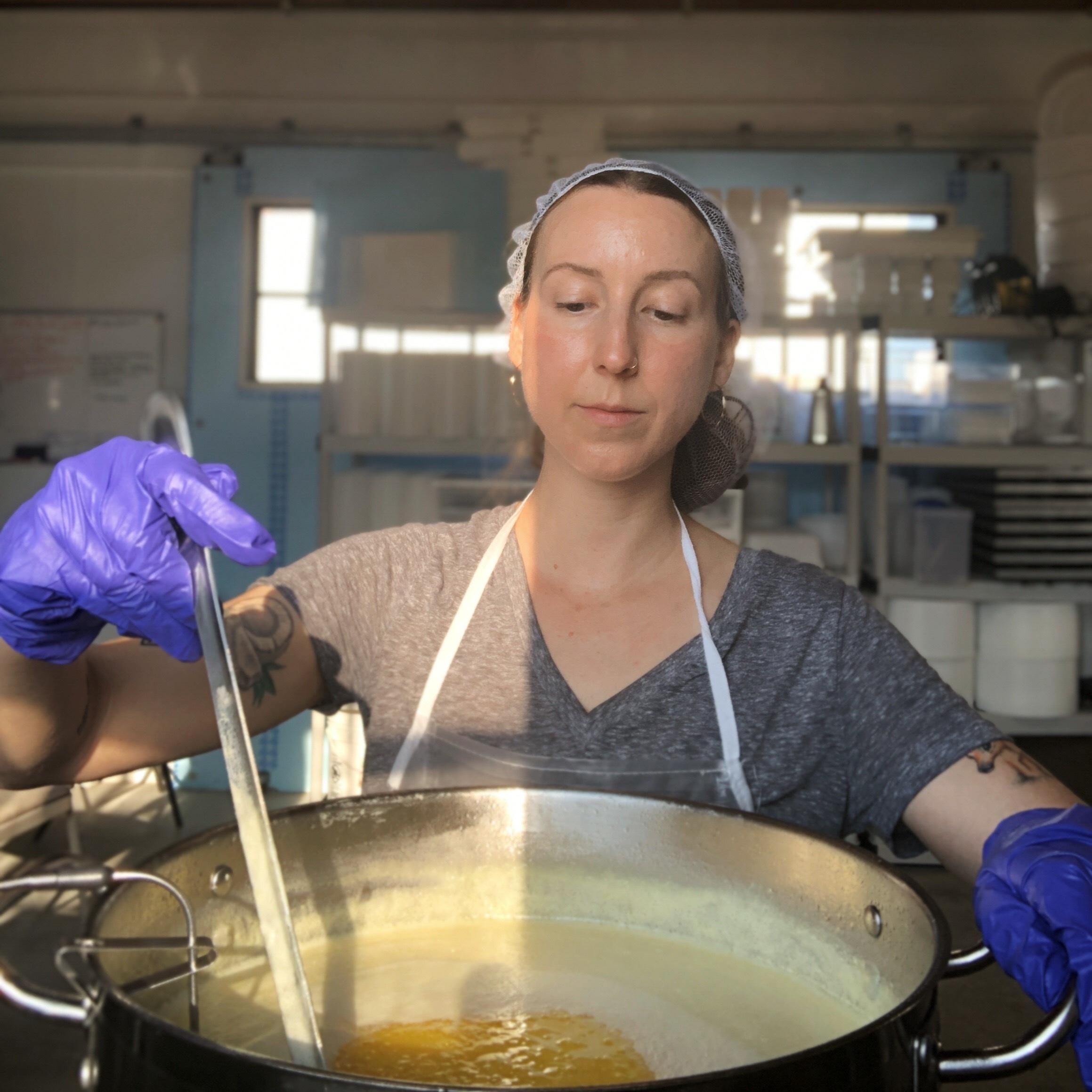 Rachel Toczko of High Lawn Farm making a batch of ghee