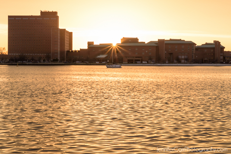 sailboat in front of portsmouth naval hospital on the elizabeth river at sunset