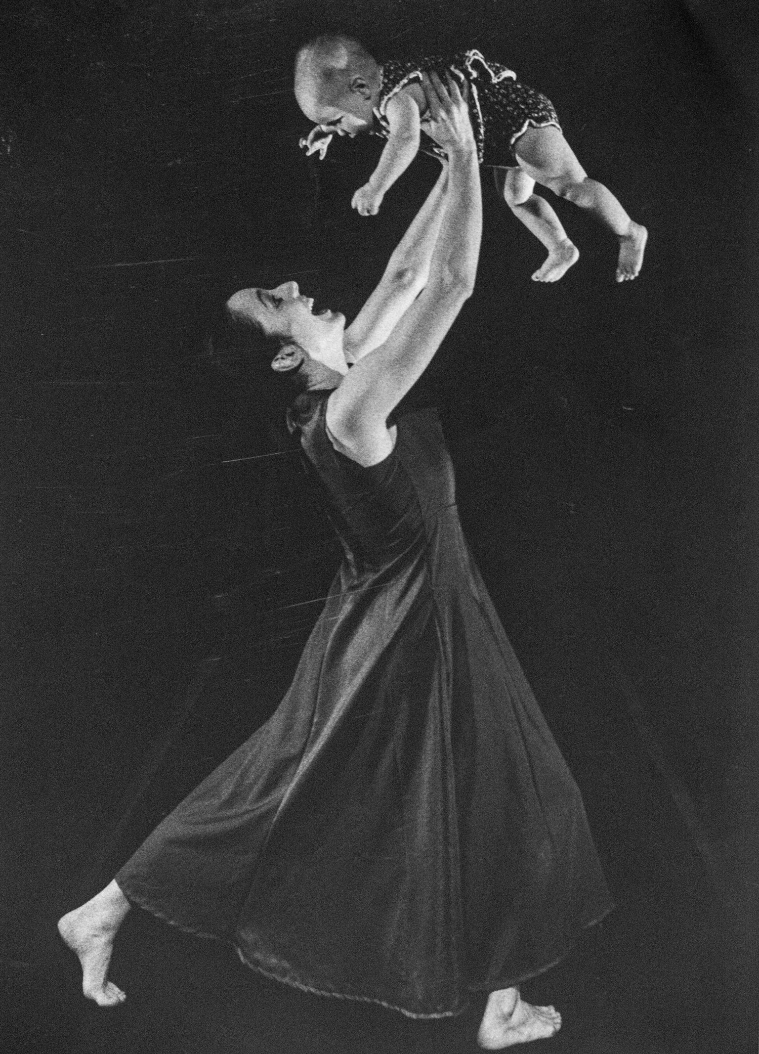Michele dances with her daughter.