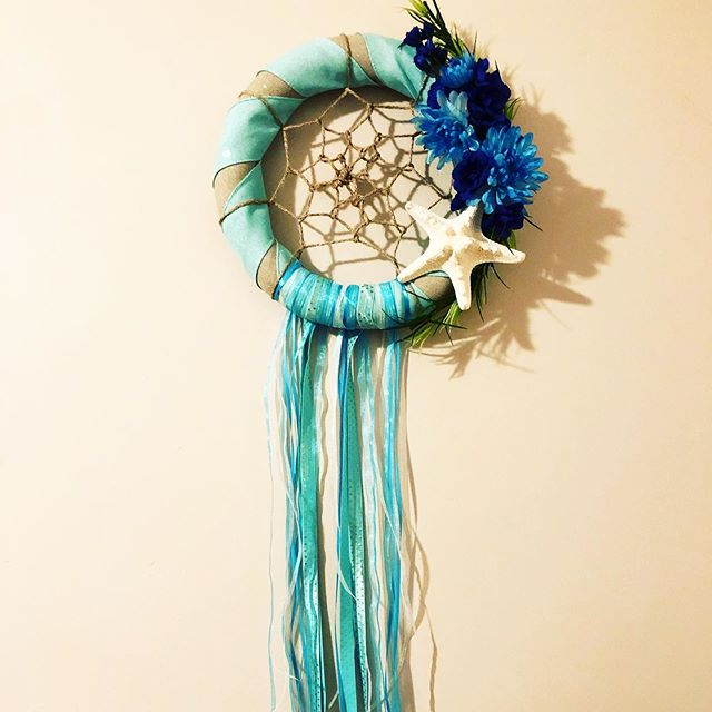 I'm dreaming of ocean waves. 🌊  Made by me @tiamarie__xo 💙💙💙 . . . . . #getcrafty #letsgetcrafty #stressreduction #artsaveslives #creativeismydefault #artsyfartsy #forsale #oceanavenue #starfish #oceandream #spiritualjunkie #diydreamcatcher #dreamcatcher #wreathsofinstagram #wreathmaking