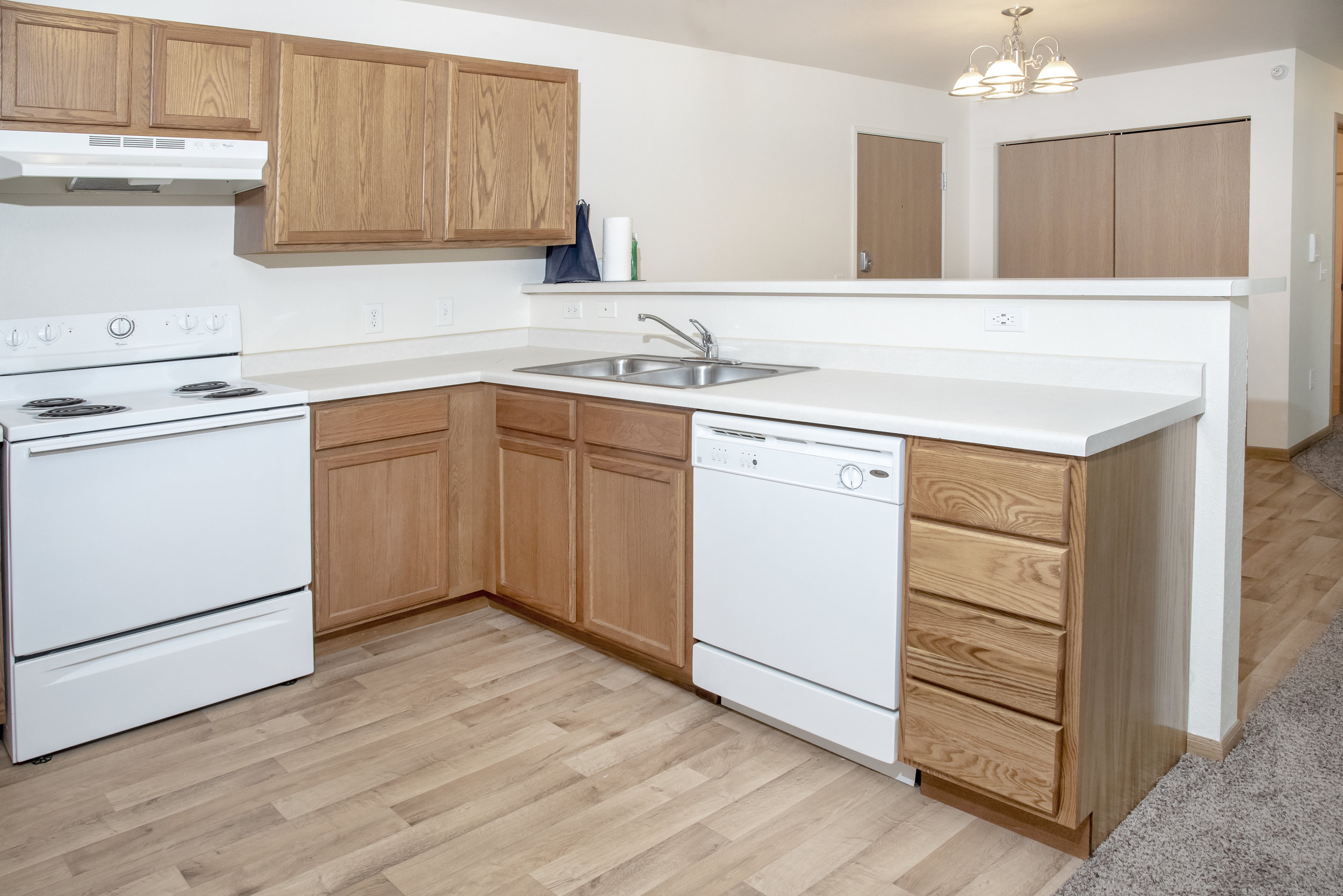 03-Updated Kitchens with Faux Wood Flooring and Laminate Countertops.jpg