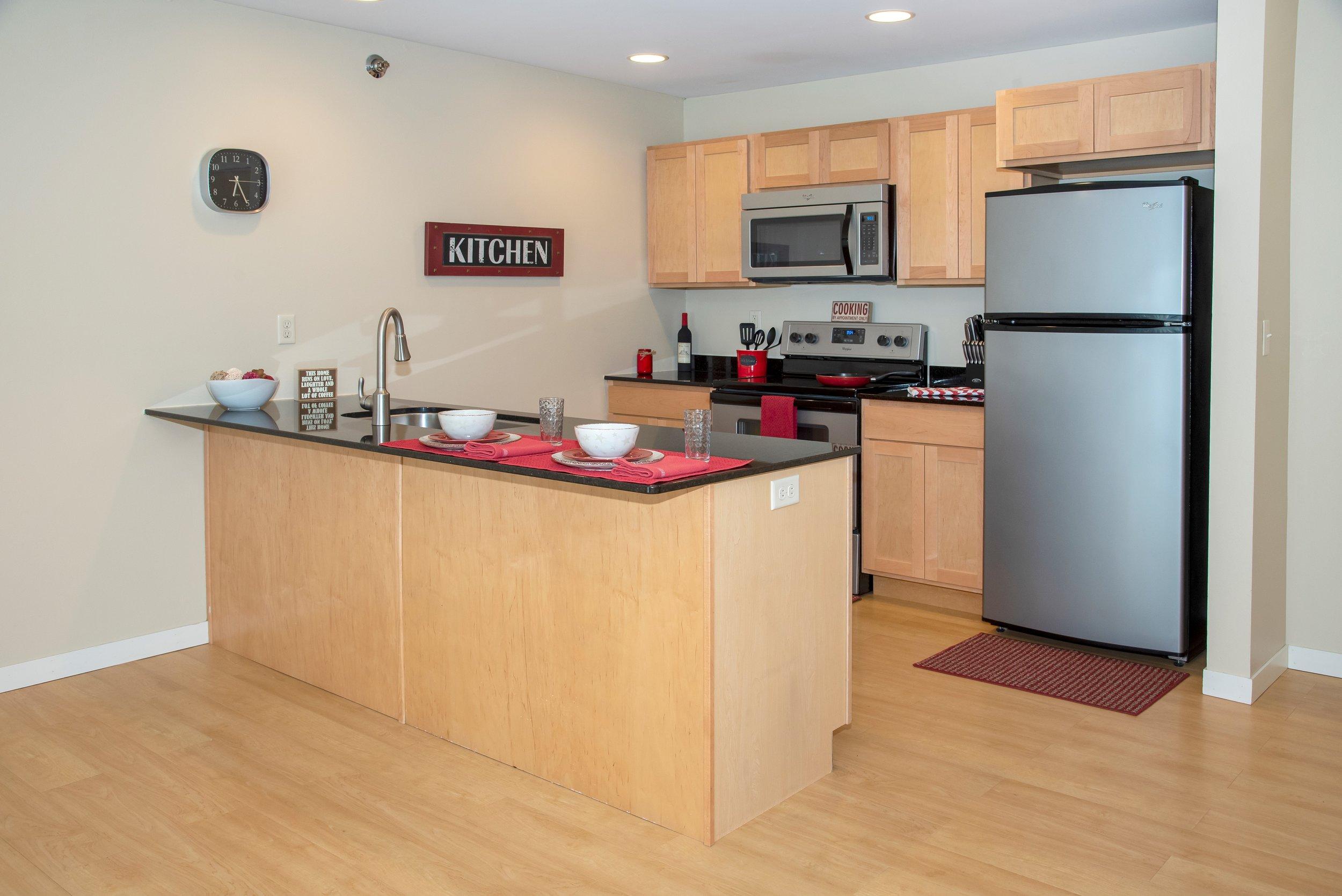 02 Stylish Kitchens with Large Breakfast Bar.jpg