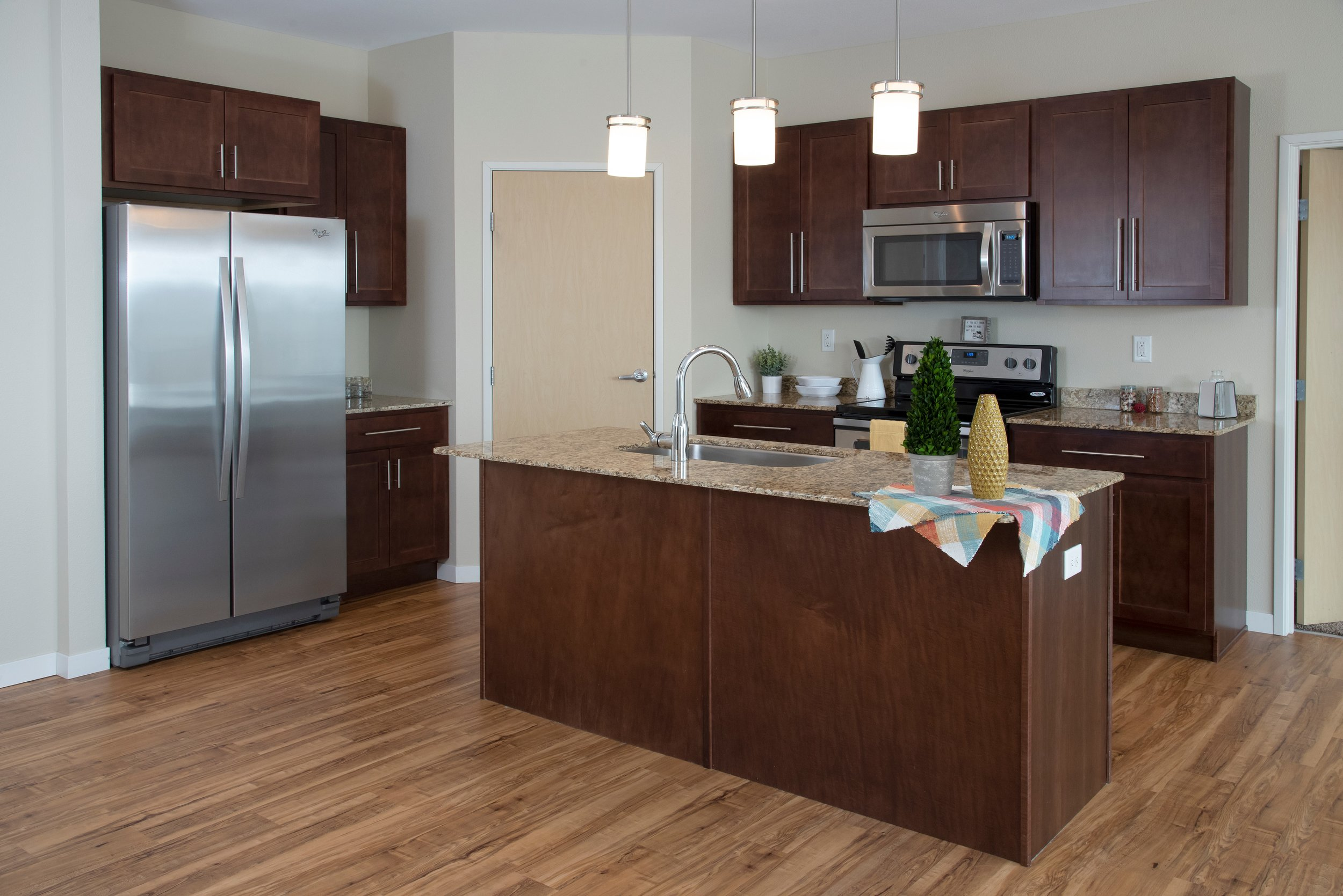 Kitchens Include Stainless Steel Appliances, Granite Counter Tops & Custom Cabinetry