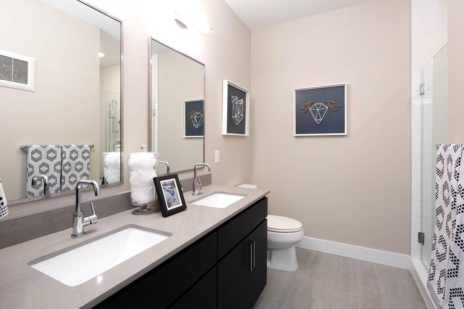 09-Luxurious Bathrooms with Quartz Countertops, Porcelain Tile Floors.jpg