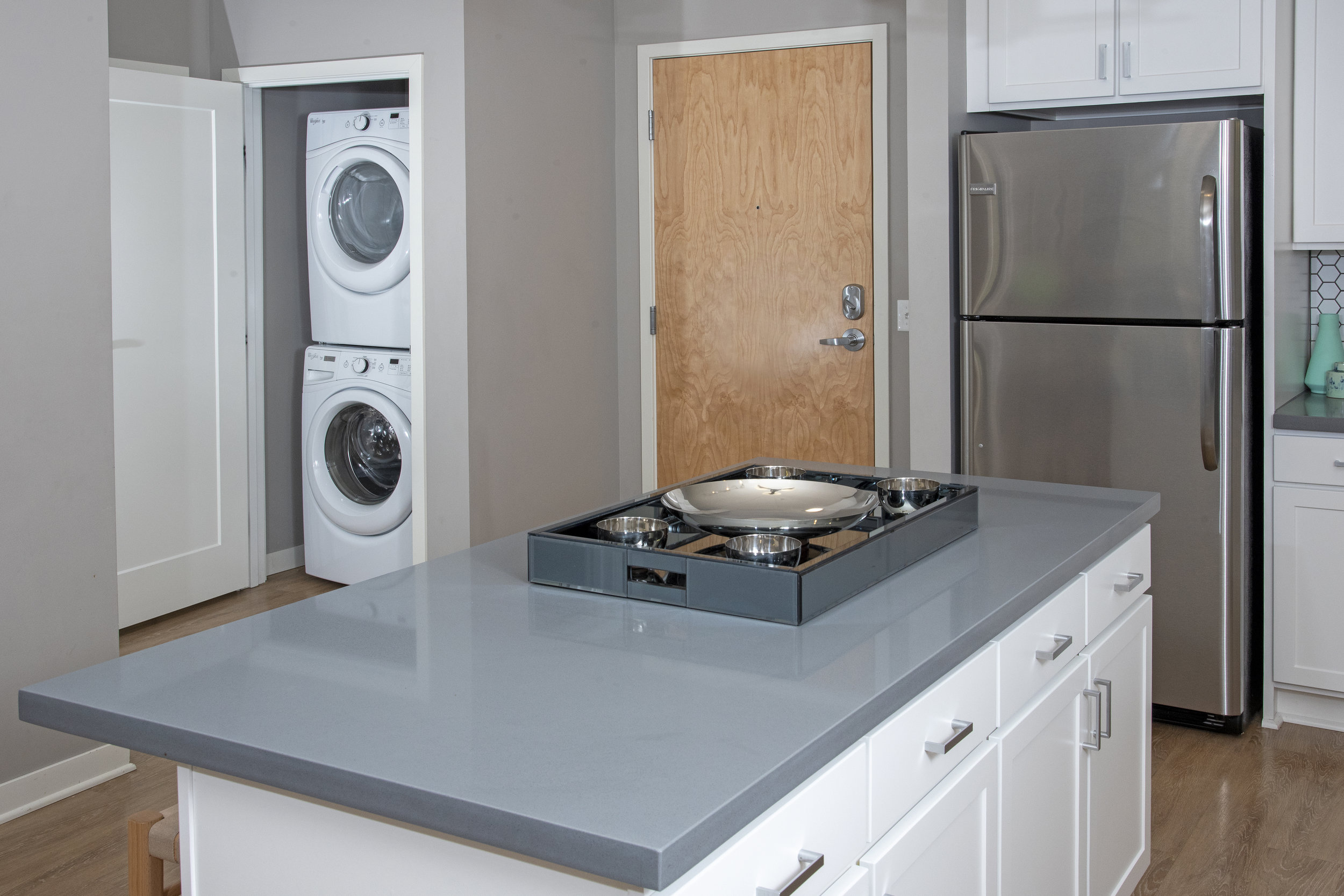 05-In-Unit Stacked Washer & Dryers.jpg