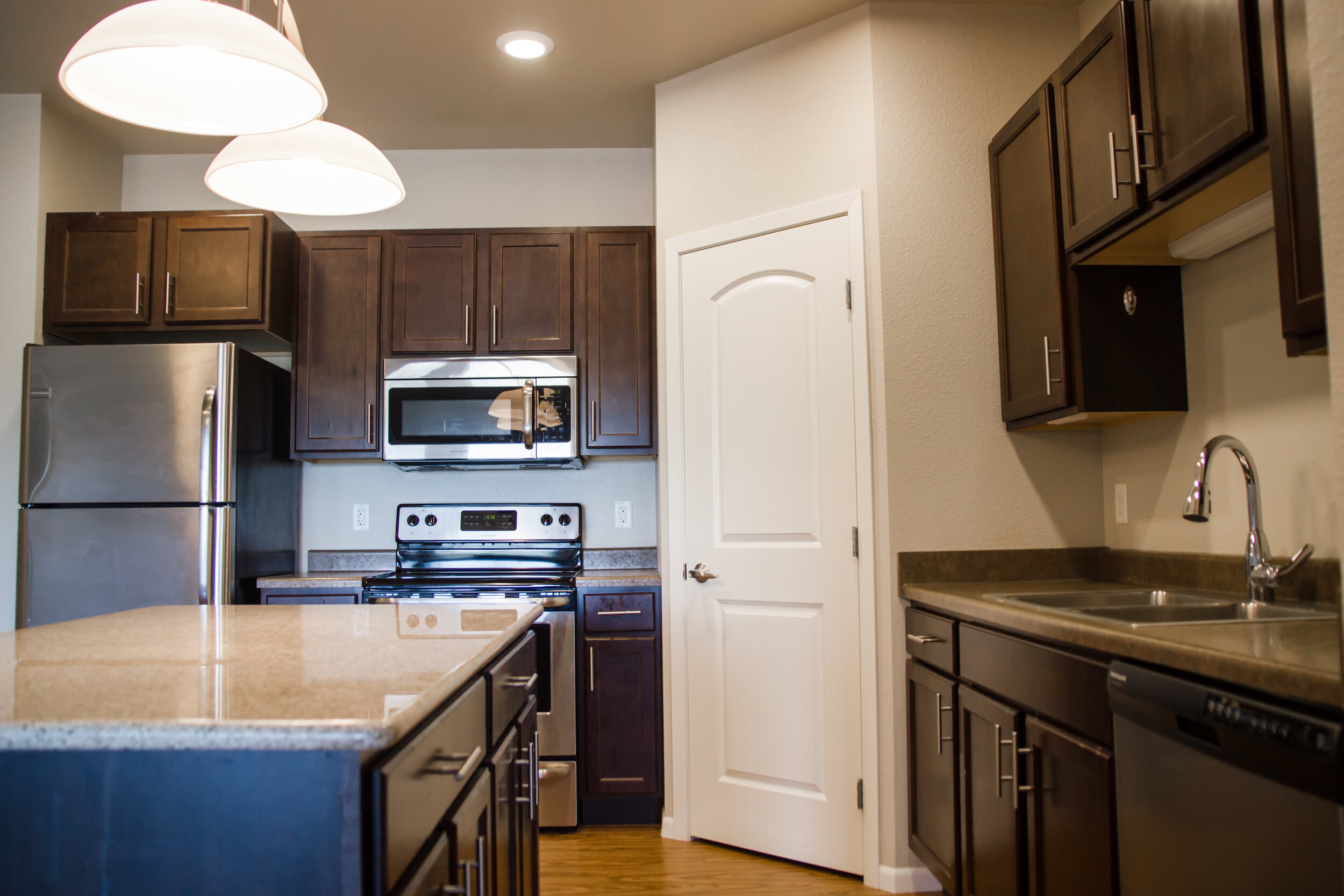 03 Great Kitchen Layouts Include Granite Countertops, an Island _ Stainless Steel Appliances.jpg