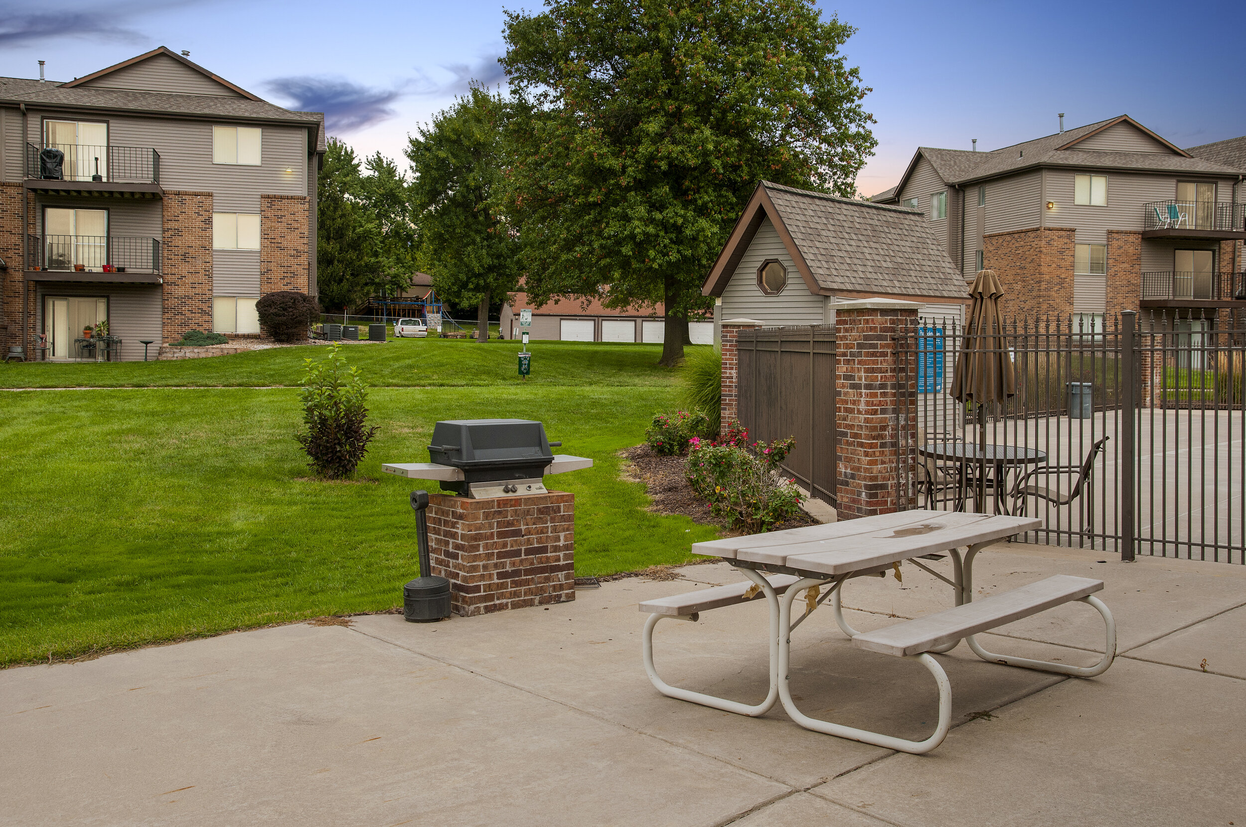 13 Beautifully Landscaped Grounds featuring Community BBQ Grill _ Picnic Area.jpg