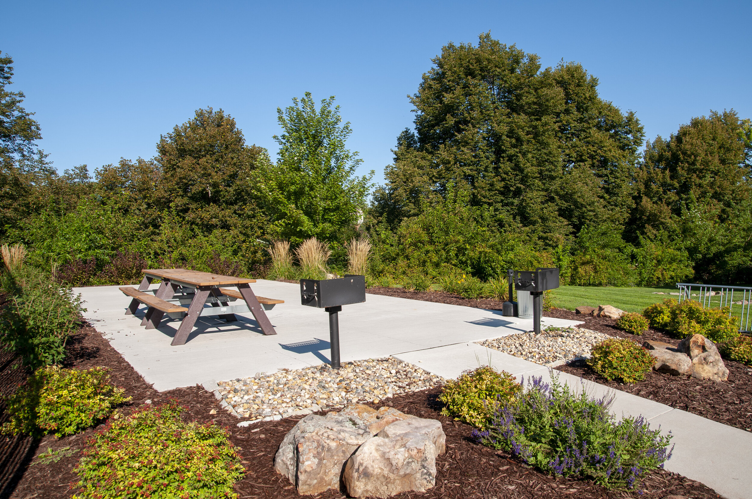 12 Beautifully Landscaped Grounds featuring a Community BBQ Grill _ Picnic Area.jpg