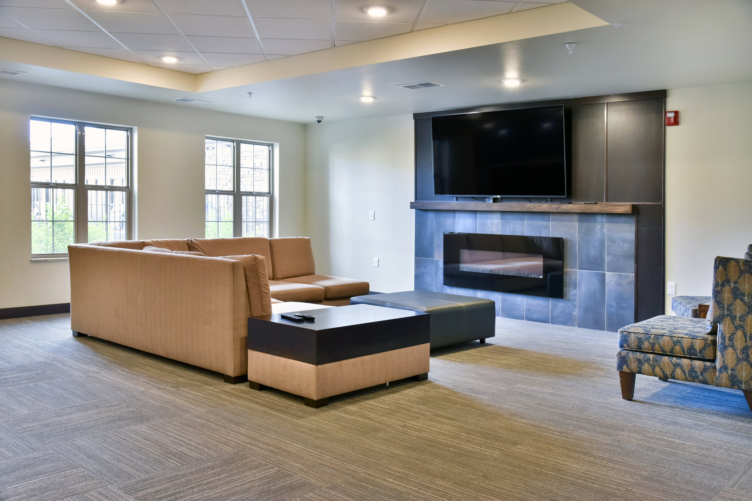 24 Catch Up on Some Shows or The Big Game Next to the Community Room Fireplace.jpg